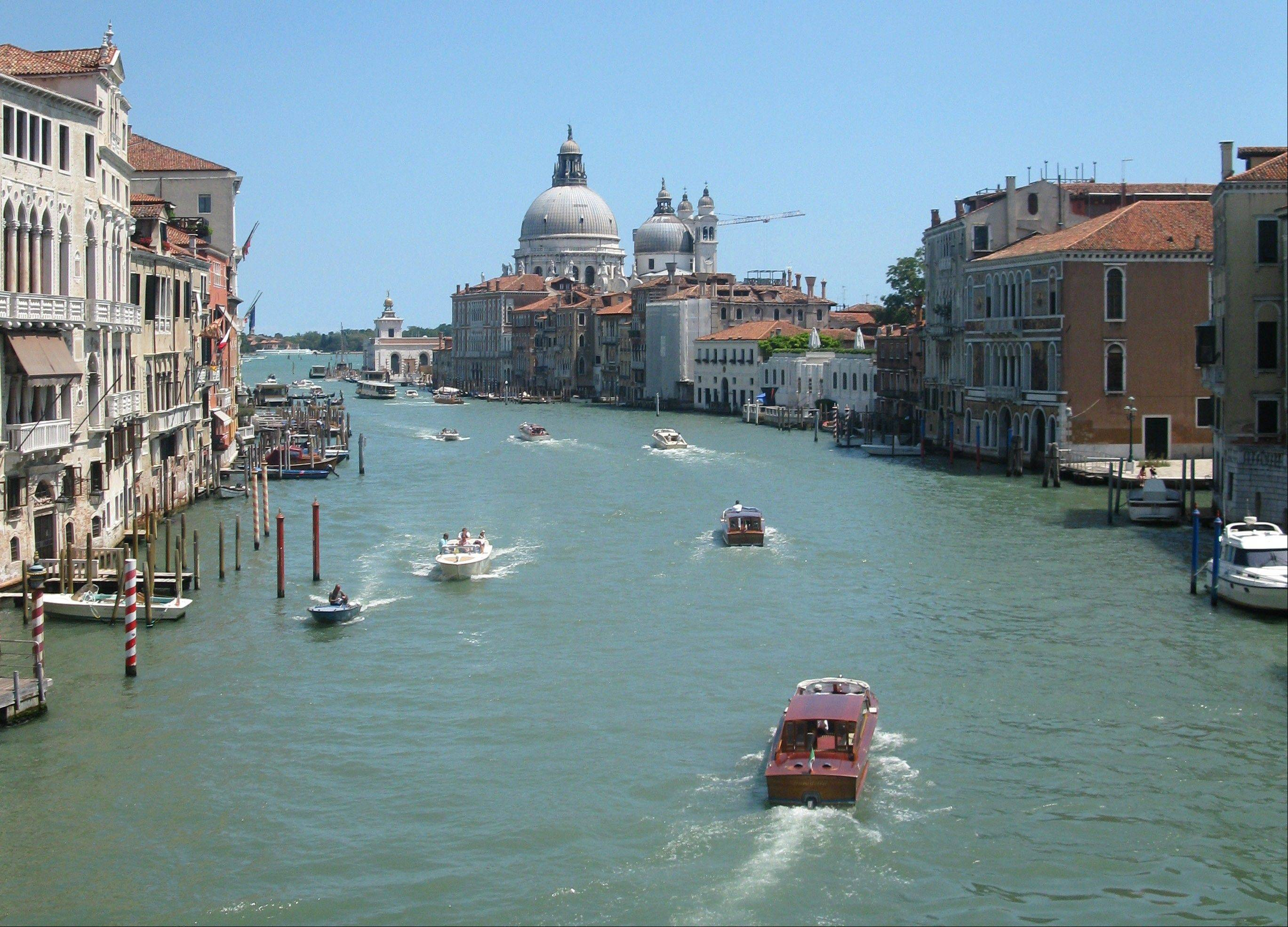 Water traffic bustles on the Grande Canale in the heart of Venice.