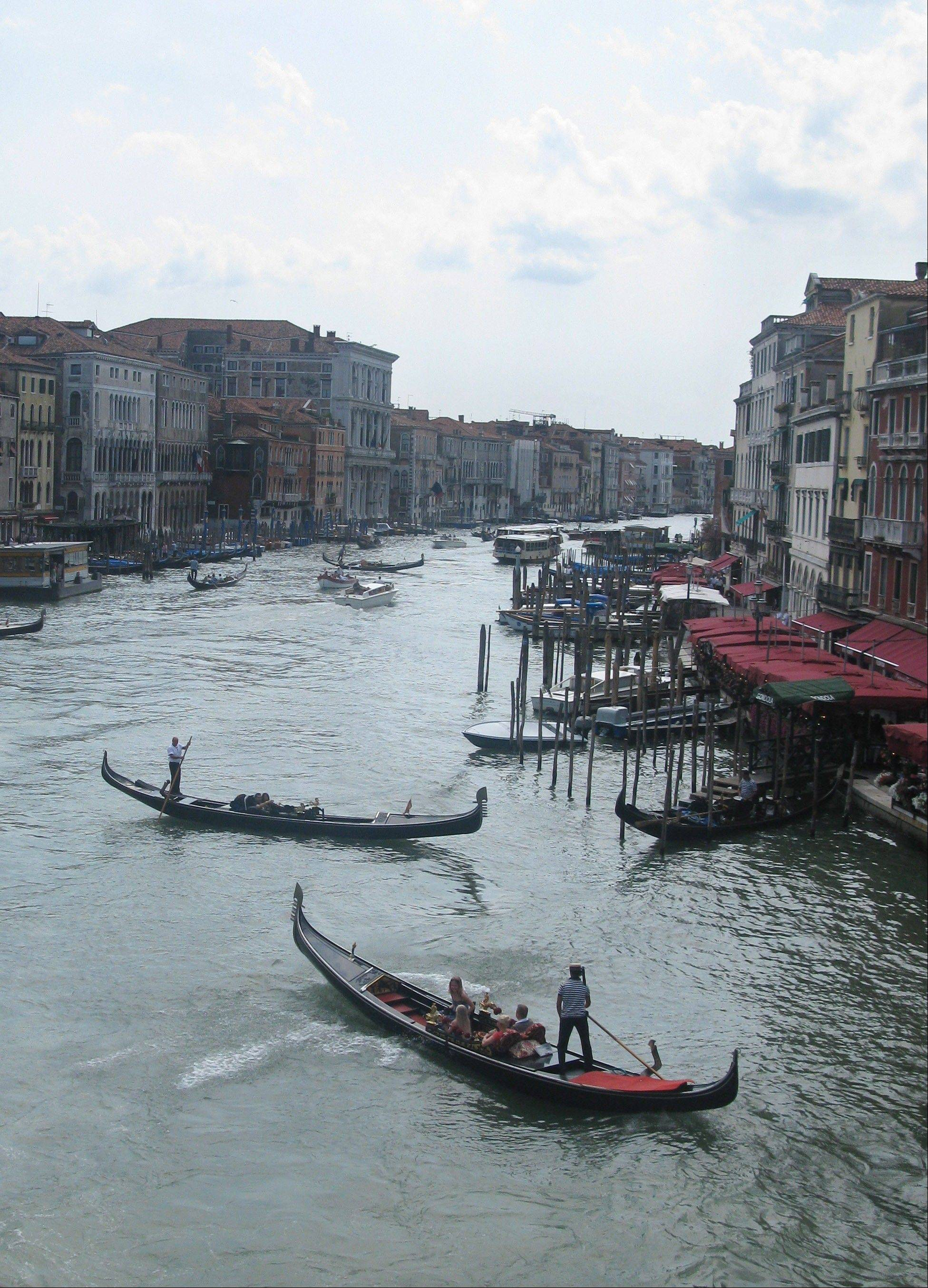 Gondolas jockey for position on the Grande Canale in Venice.