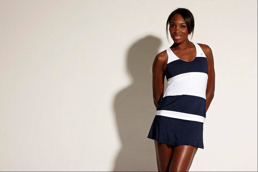 Professional tennis player and fashion designer Venus Williams shows off a Blue Slice Tank from the EleVen By Venus Williams Summer 2013 collection.