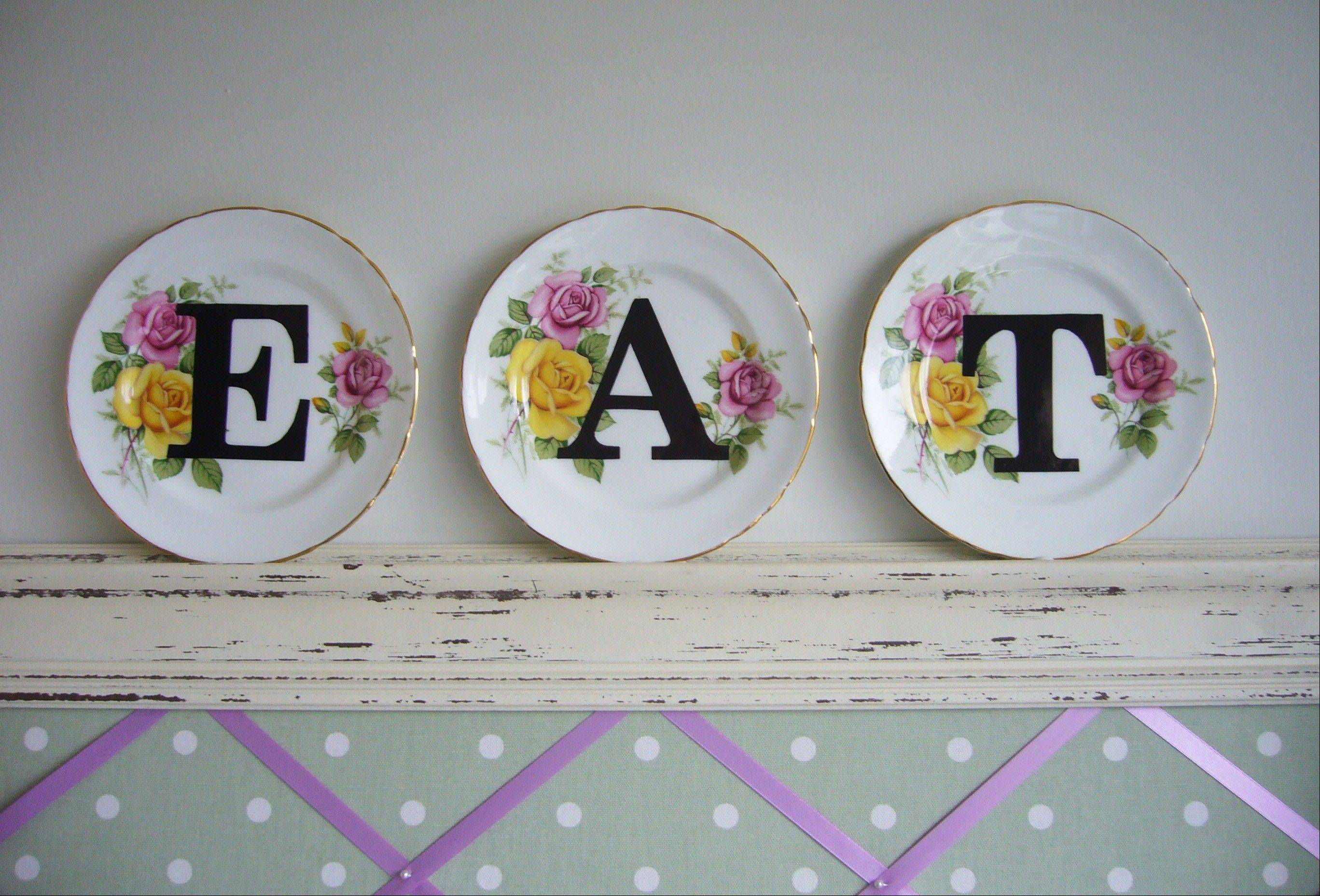 "The vintage-plate-decorating project upcycled with modern letter print described on the lifestyle blog ""angel in the north"" is shown in its completed form. The blog is run by Anna Nicholson of West Yorkshire, England."