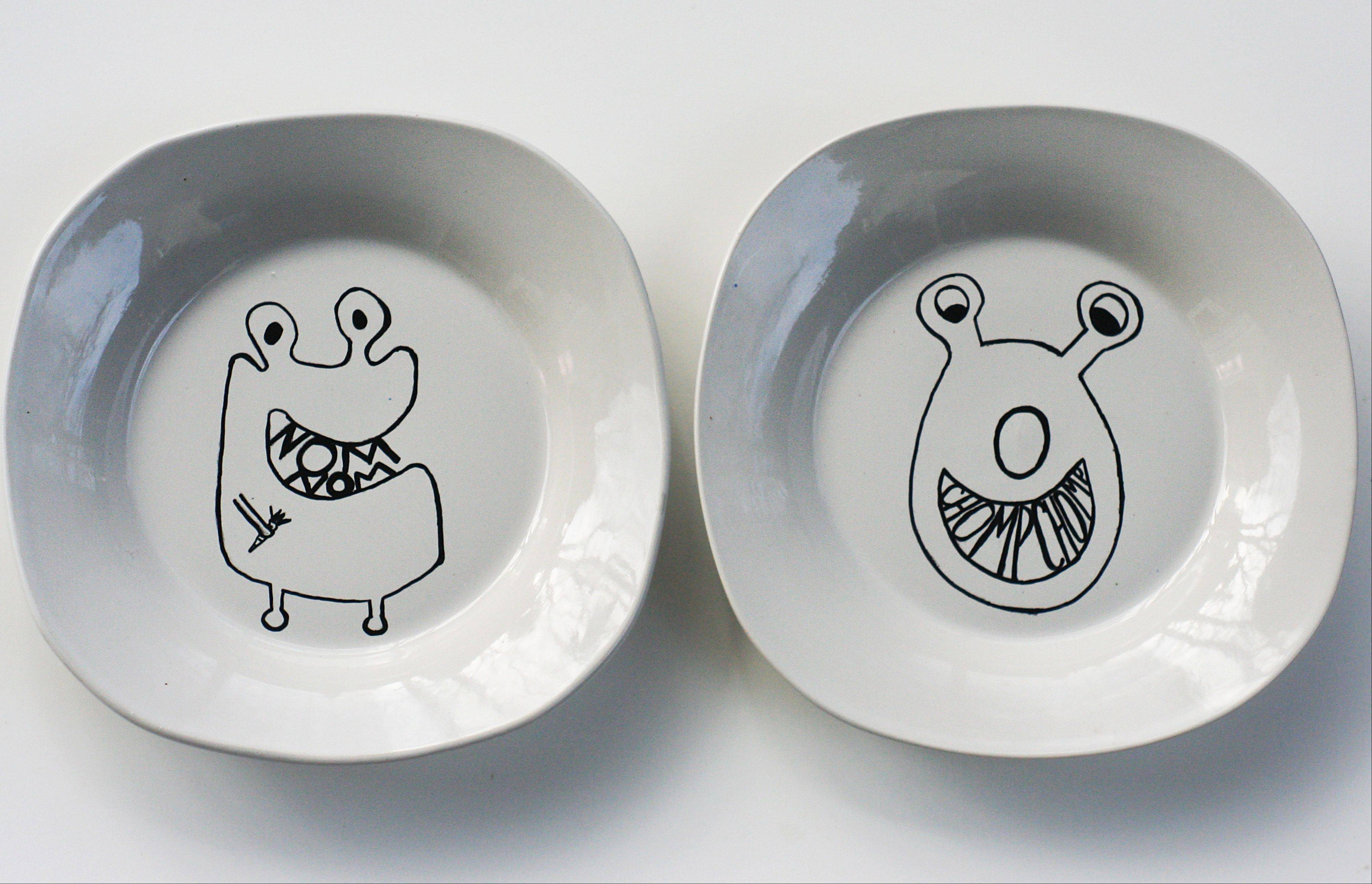 "Two plates displaying original monster characters created by crafting blogger, Christine Dinsmore, who describes her plate-decorating project on the blog ""The Plumed Nest,"" in Portland, Ore."