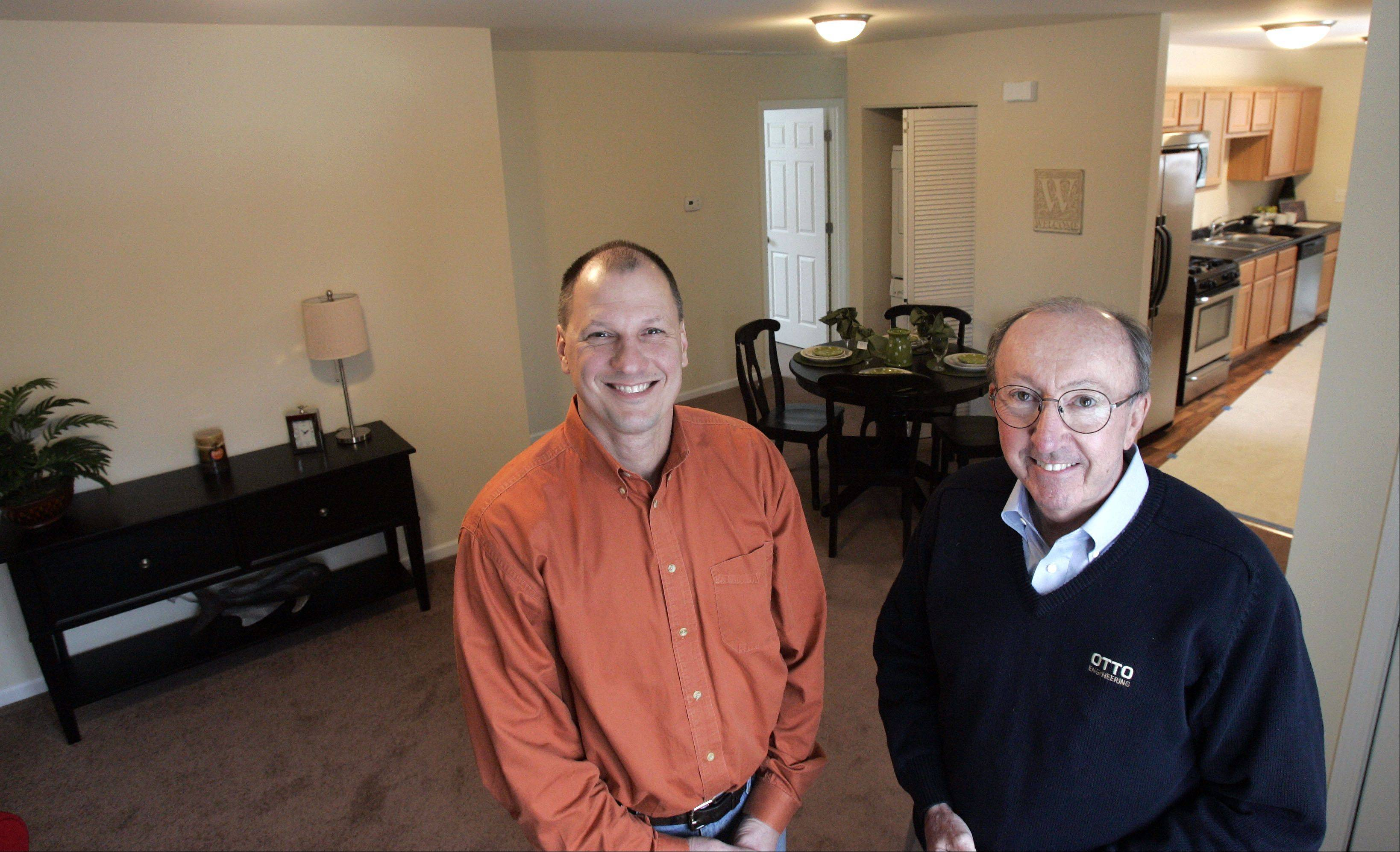 Facilities manager Jerry Skowronski, left, and Tom Roeser of Homes by OTTO are successfully rehabbing a neighborhood in Carpentersville.