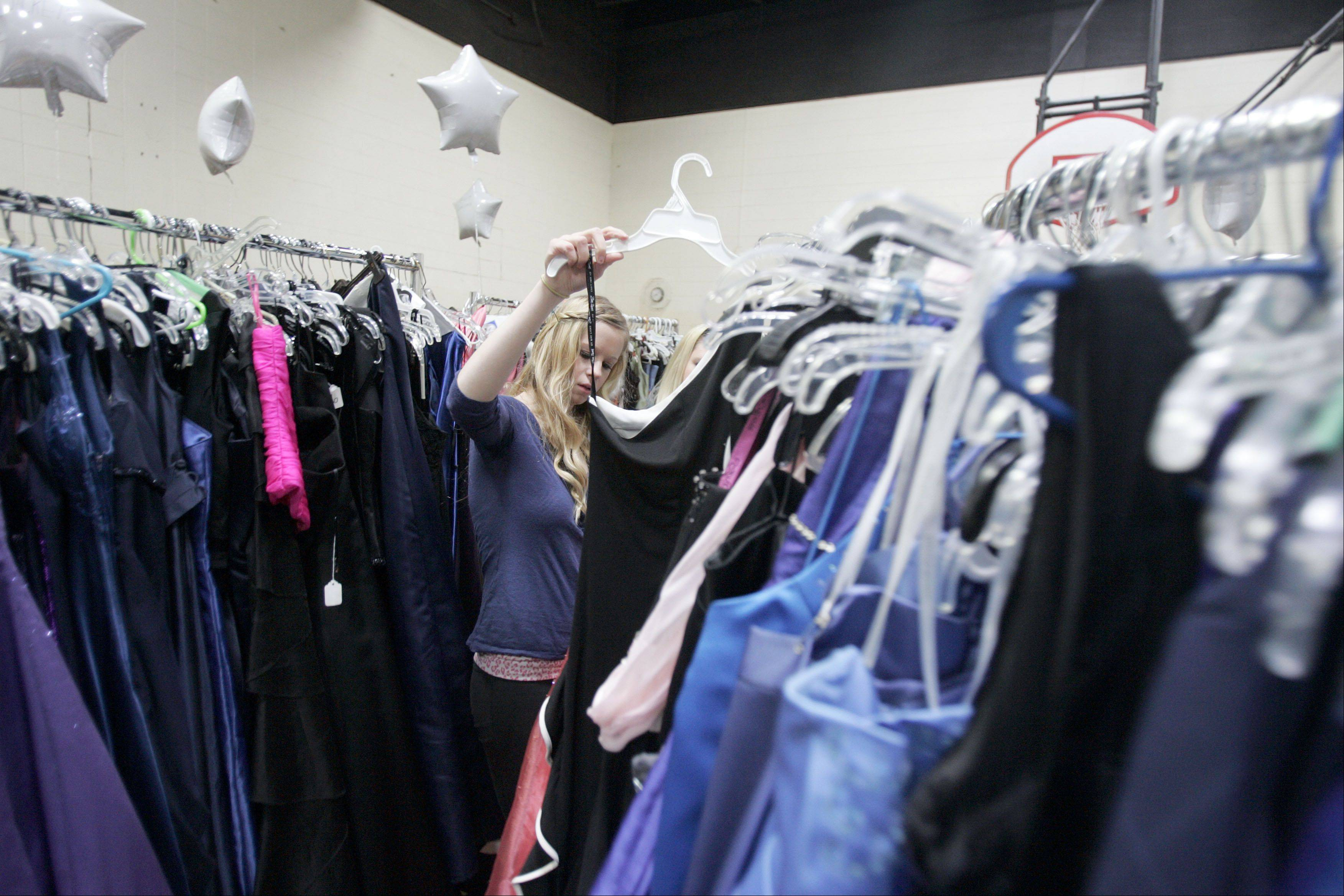Seventeen-year-old Diana Pannell of St. Charles picks from more than 4,000 dresses during the annual Cinderella's Closet event Saturday at the YWCA in Elgin.