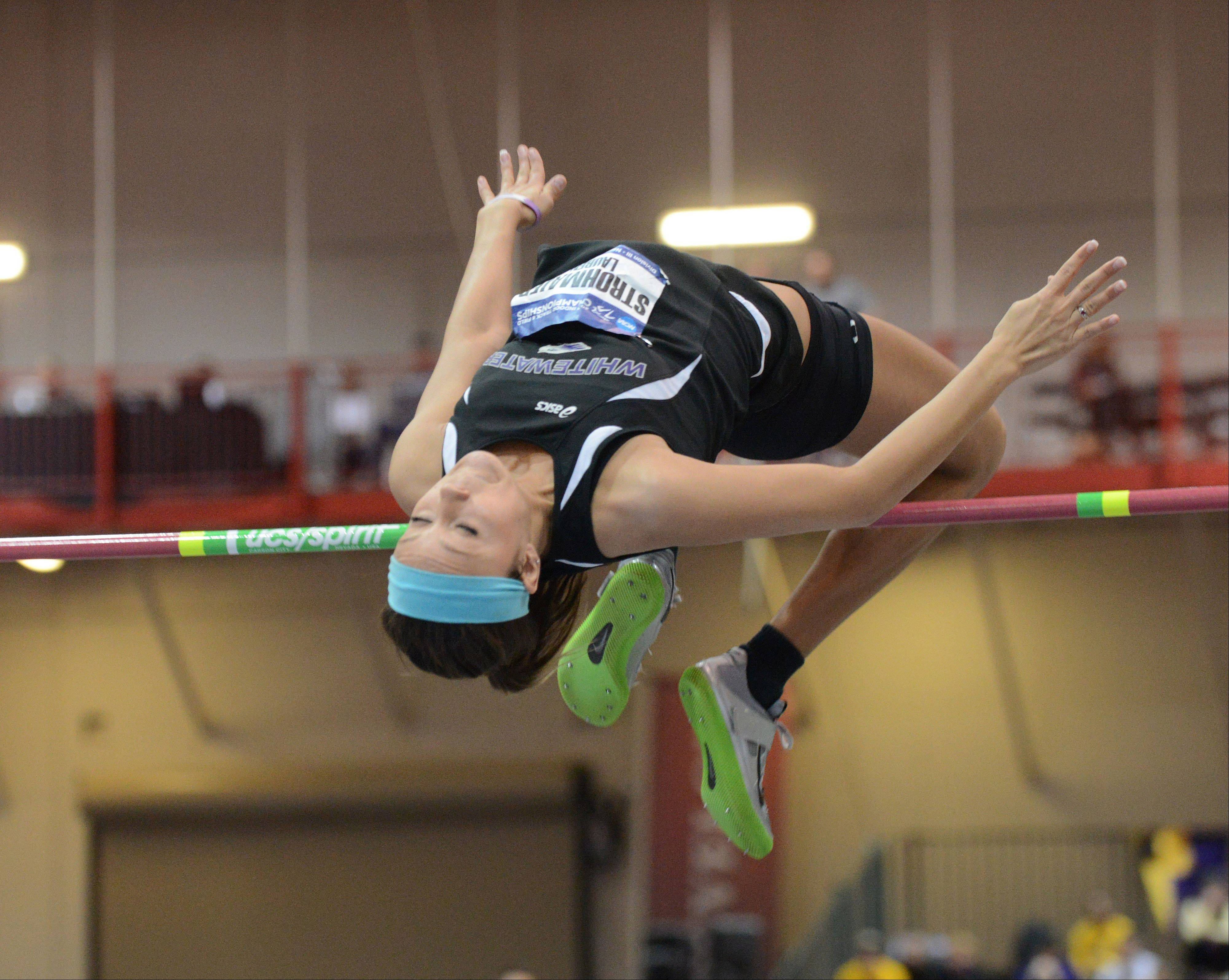 Lauren Strohmaier of the University of Wisconsin-Whitewater takes a leap in the high jump during Saturday's NCAA Division III Indoor Track and Field Championships at North Central College. About 470 athletes competed in 15 events during the two-day championship meet.
