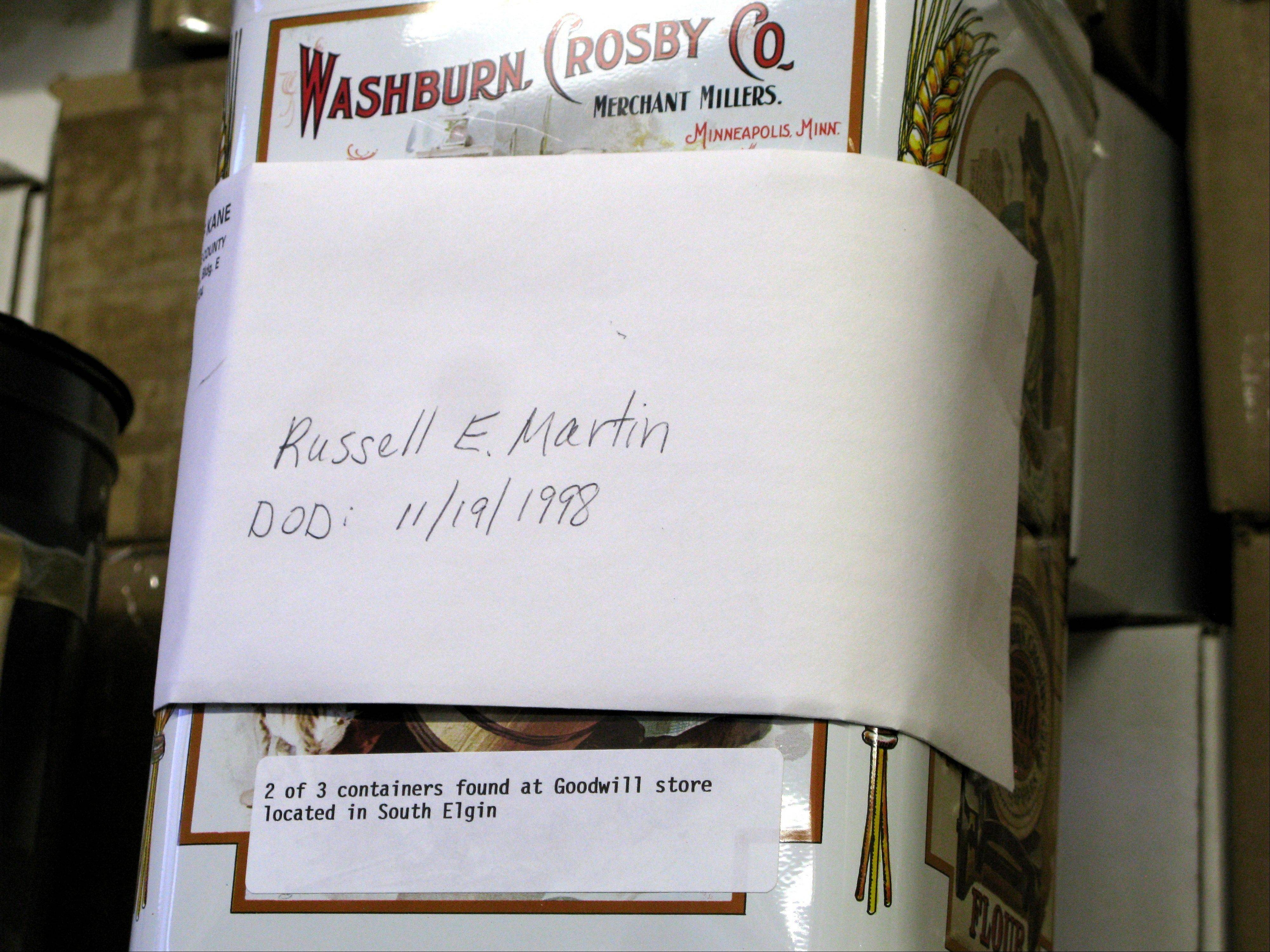 An old flour tin contains the remains of Russell E. Martin. It is one of three containers of ashes discovered together at the Goodwill store in South Elgin.