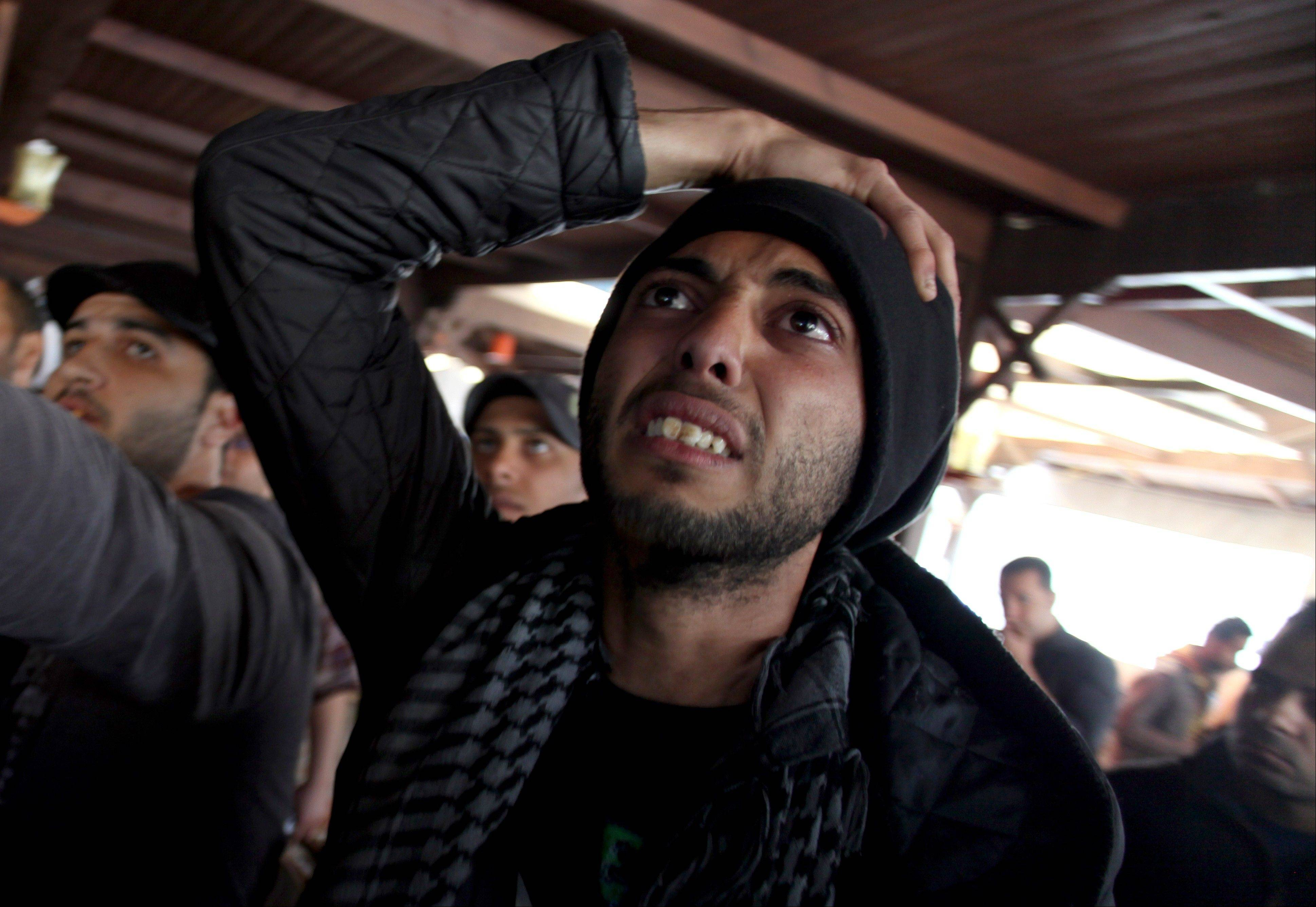 An Egyptian man reacts Saturday as he watches a televised court verdict confirming death sentences against 21 people for their role in a deadly 2012 soccer riot, in a coffee shop in Port Said, Egypt.
