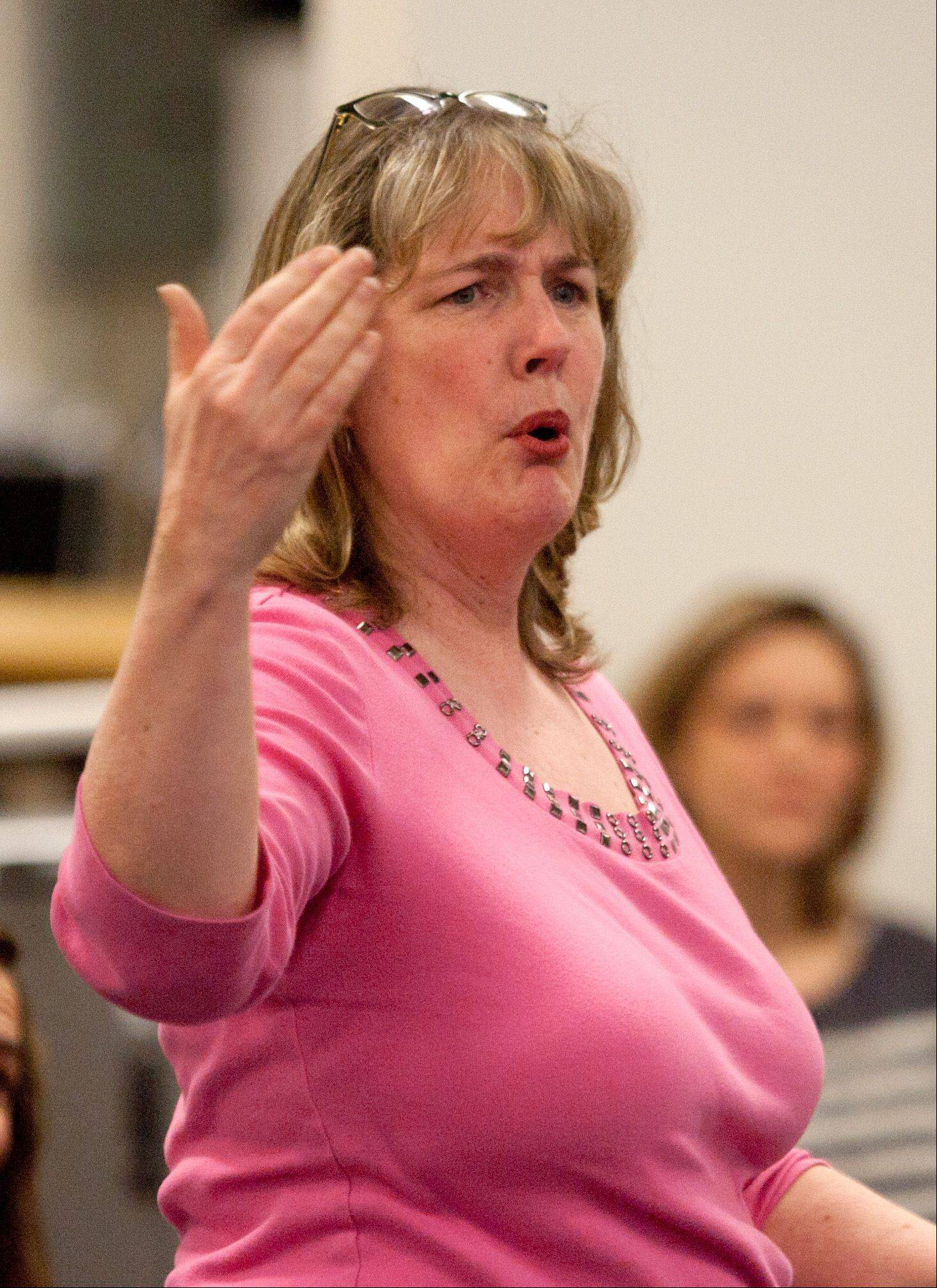 Sue Burdett of Glen Ellyn speaks out Saturday at the Glen Ellyn District 41 community forum concerning the controversial Think Tank proposal.