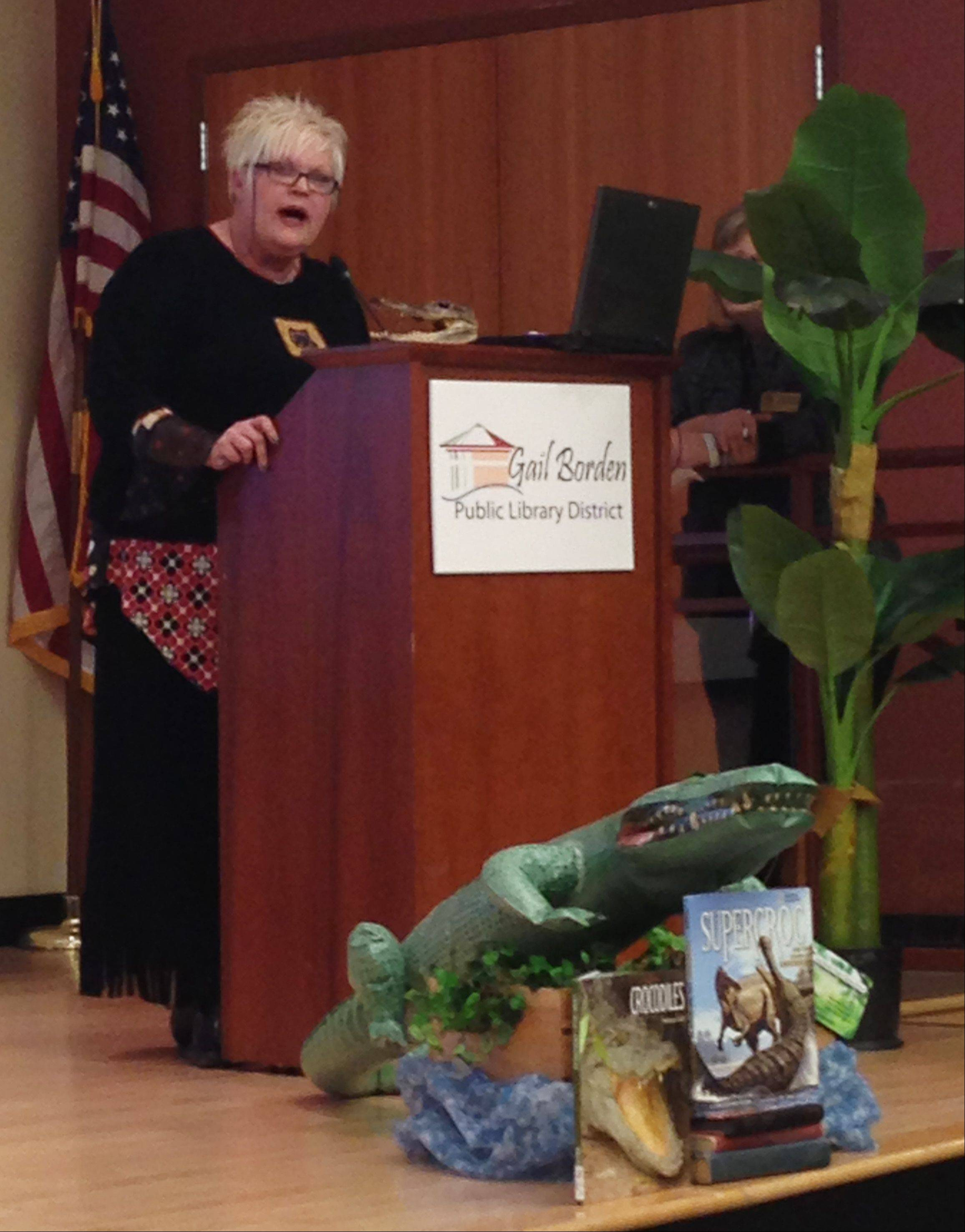 Sigi Psimenos, a board member for the Elgin Community Network, talks about the upcoming What the Croc public outdoor art exhibit and competition in Elgin.