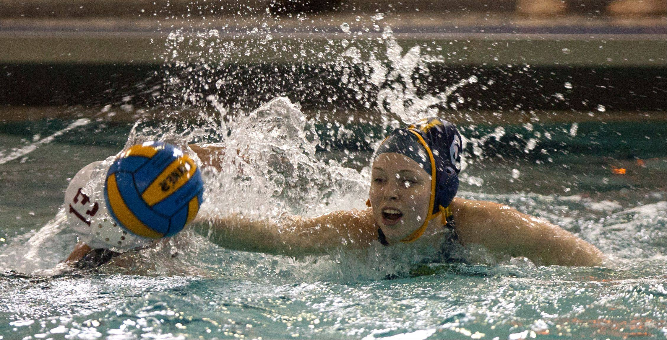 Neuqua Valley's Ann Kathrin Becker, center, breaks away from Naperville Central's Jenny Doyle, (13), during the Naperville Quint girls varsity water polo tournament.