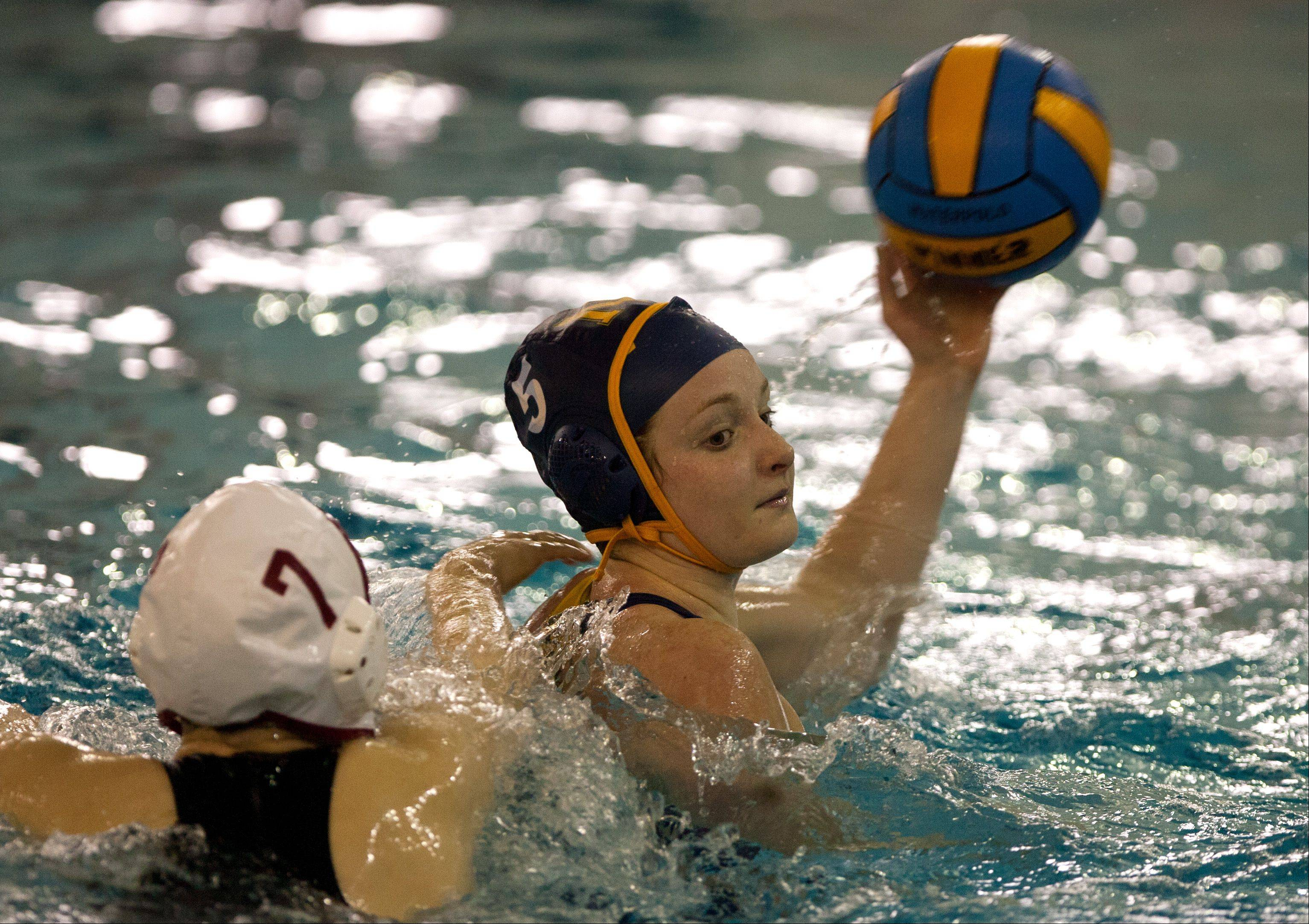 Naperville Central's Beth Ryan, left, pursues Neuqua Valley's Brooke Bedford, right, during the Naperville Quint girls varsity water polo tournament.