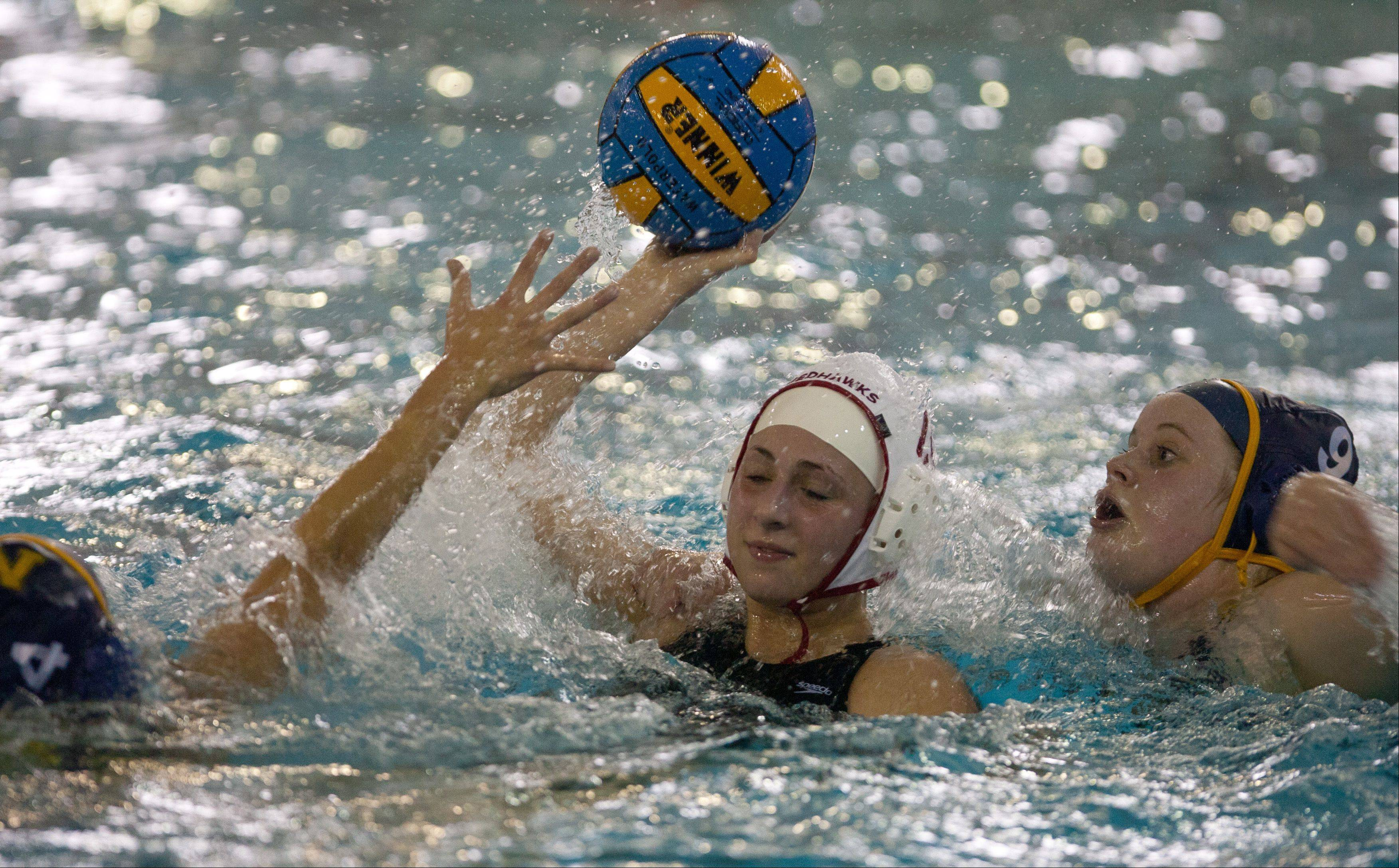 Naperville Central's Leslie Calabrese looks to pass while Neuqua Valley's Deanna Hoff defends, during the Naperville Quint girls varsity water polo tournament.