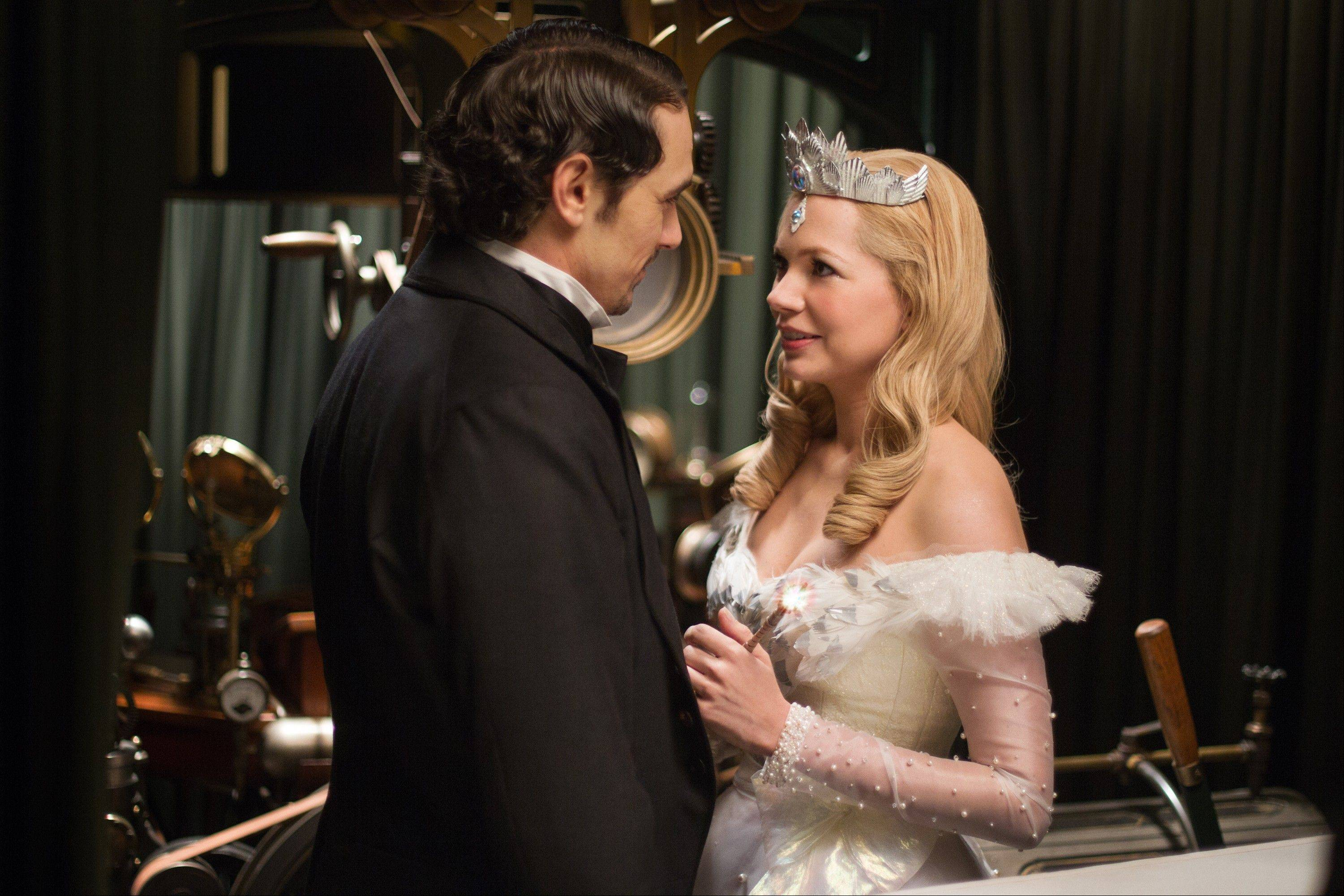 "This film image released by Disney Enterprises shows James Franco, left, and Michelle Williams in a scene from ""Oz the Great and Powerful."""