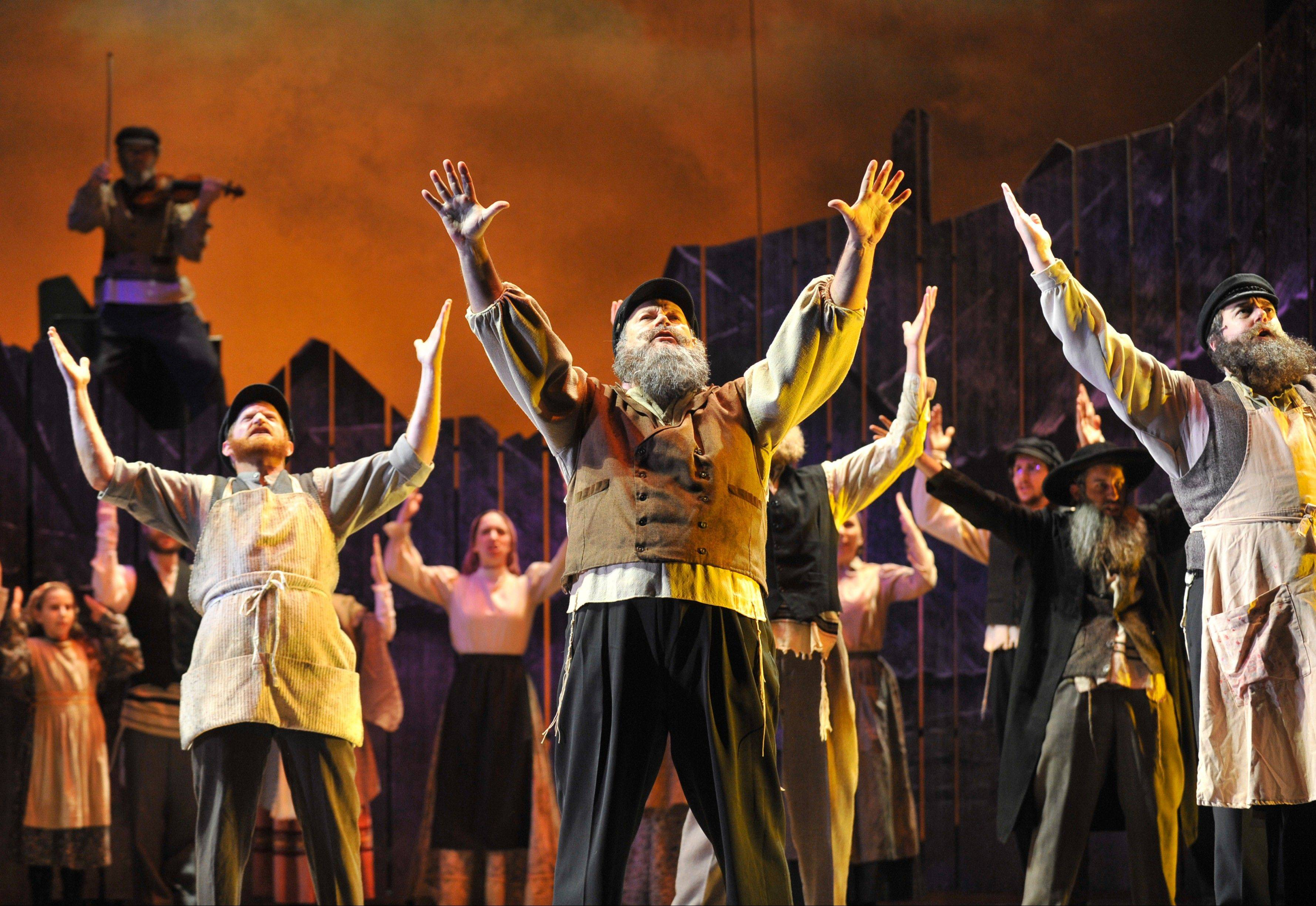 "David Girolmo delivers a showstopping performance as Tevye in Paramount Theatre's stellar revival of ""Fiddler on the Roof."""
