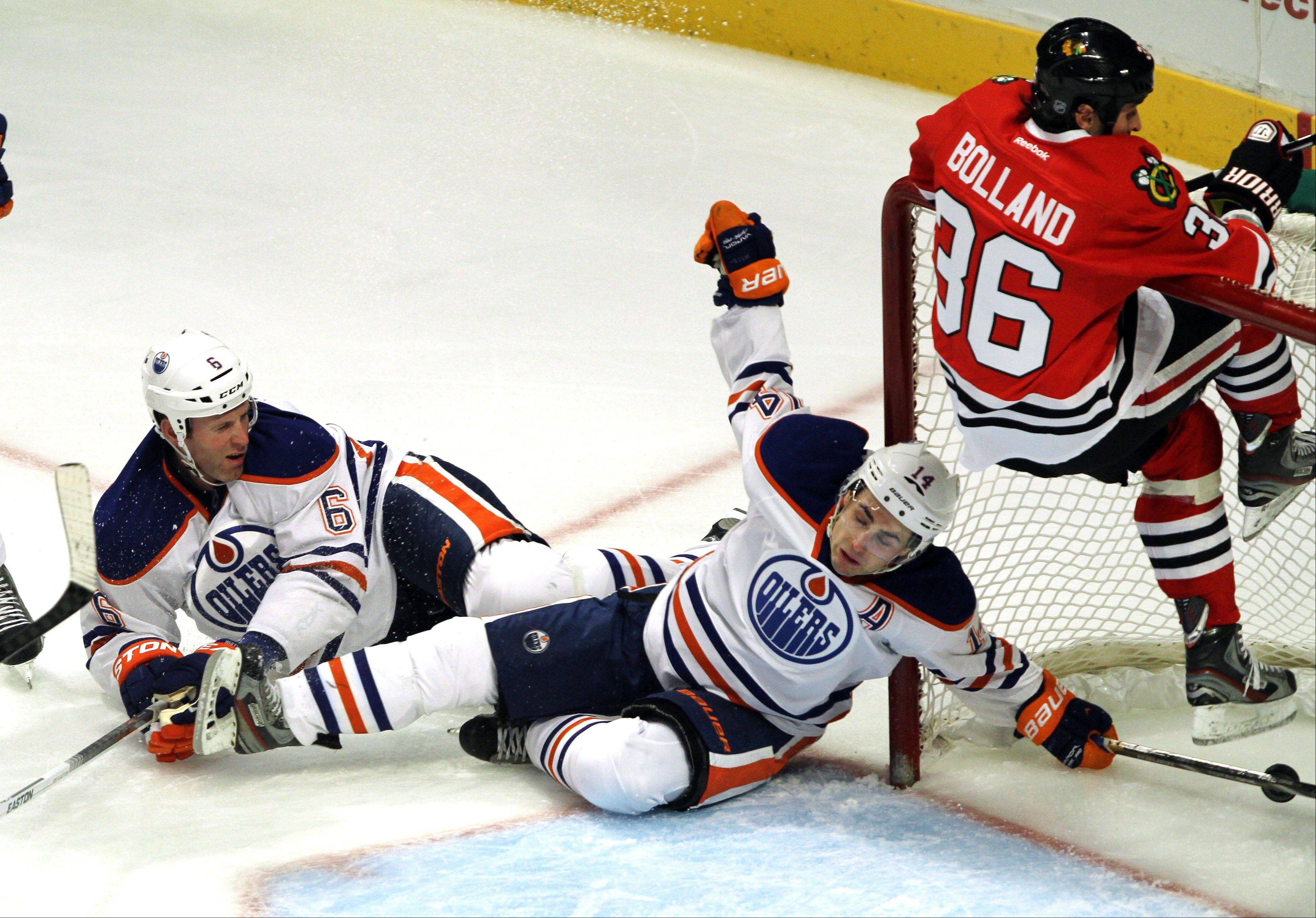 Blackhawks center Dave Bolland runs into the net as Patrick Kane scores in Sunday�s second period at United Center. It was a wild goal in a wild game that saw the Edmonton Oilers hold on for a 6-5 victory.