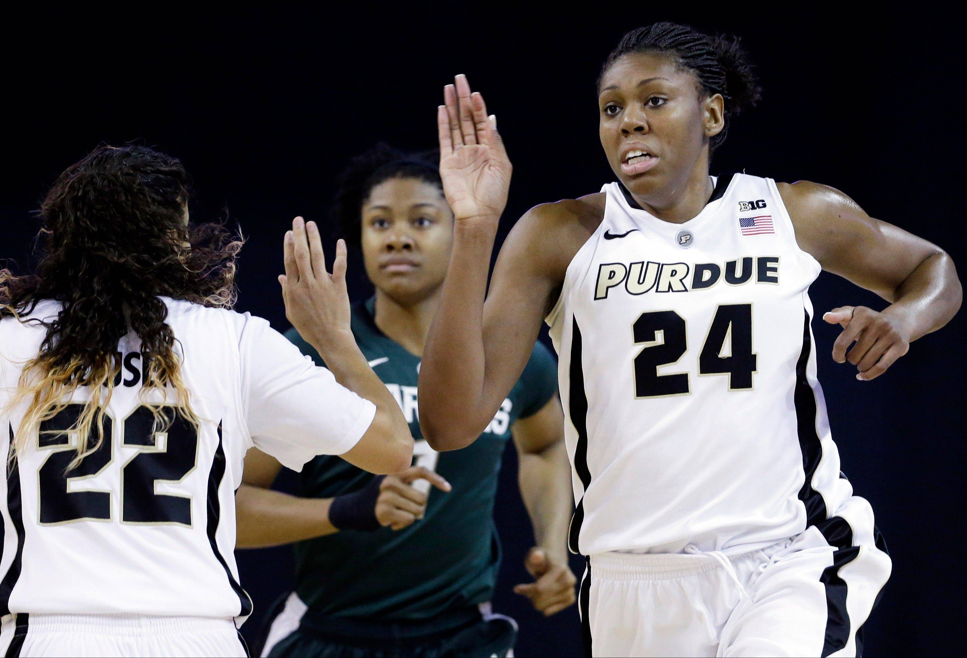 Purdue forward Drey Mingo, right, celebrates with guard KK Houser after scoring a basket during the first half of an NCAA college basketball game against Michigan State in the Big Ten Conference tournament in Hoffman Estates on Sunday.