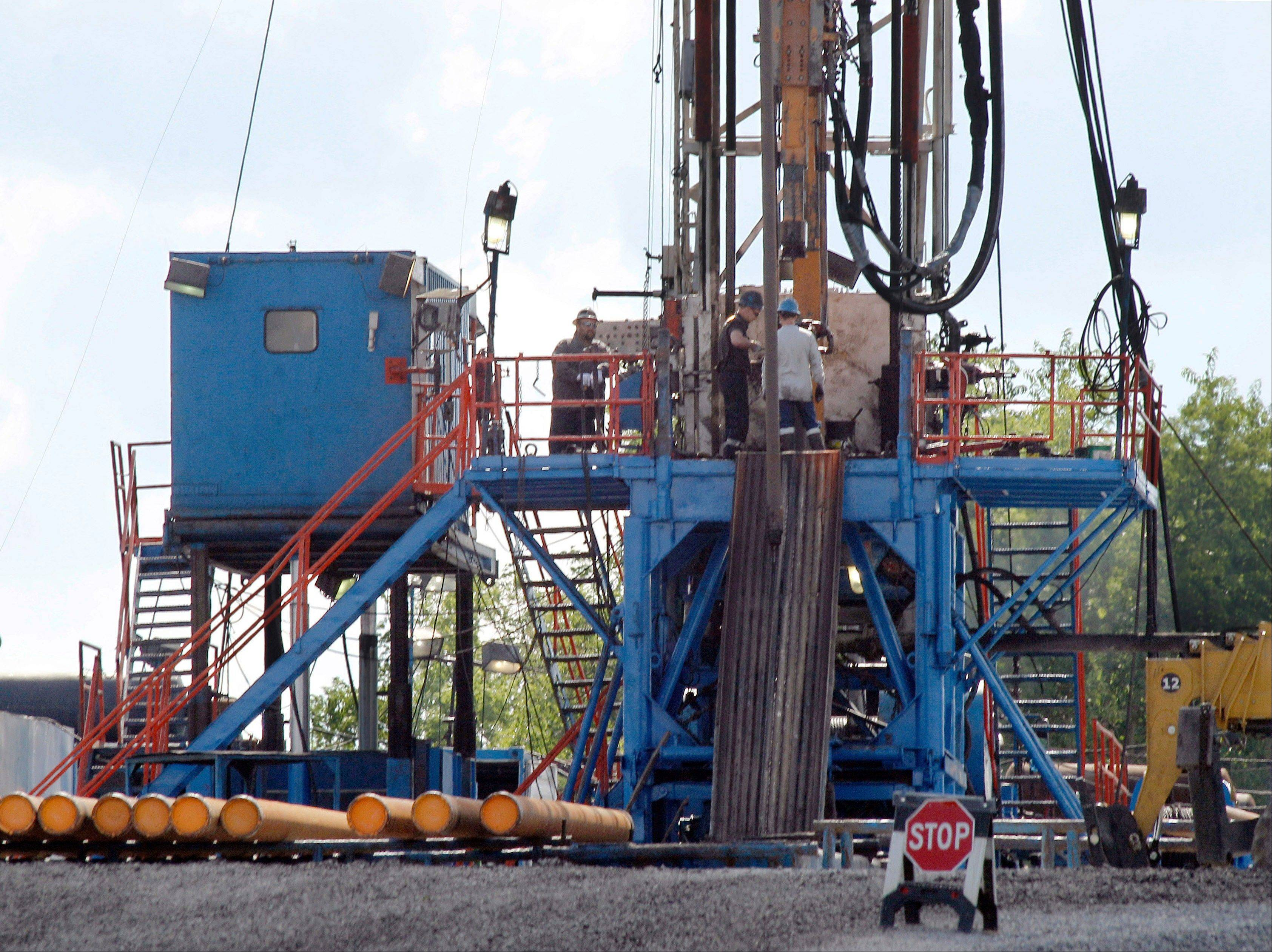 A crew works on a gas drilling rig at a well site for shale based natural gas in Zelienople, Pa.