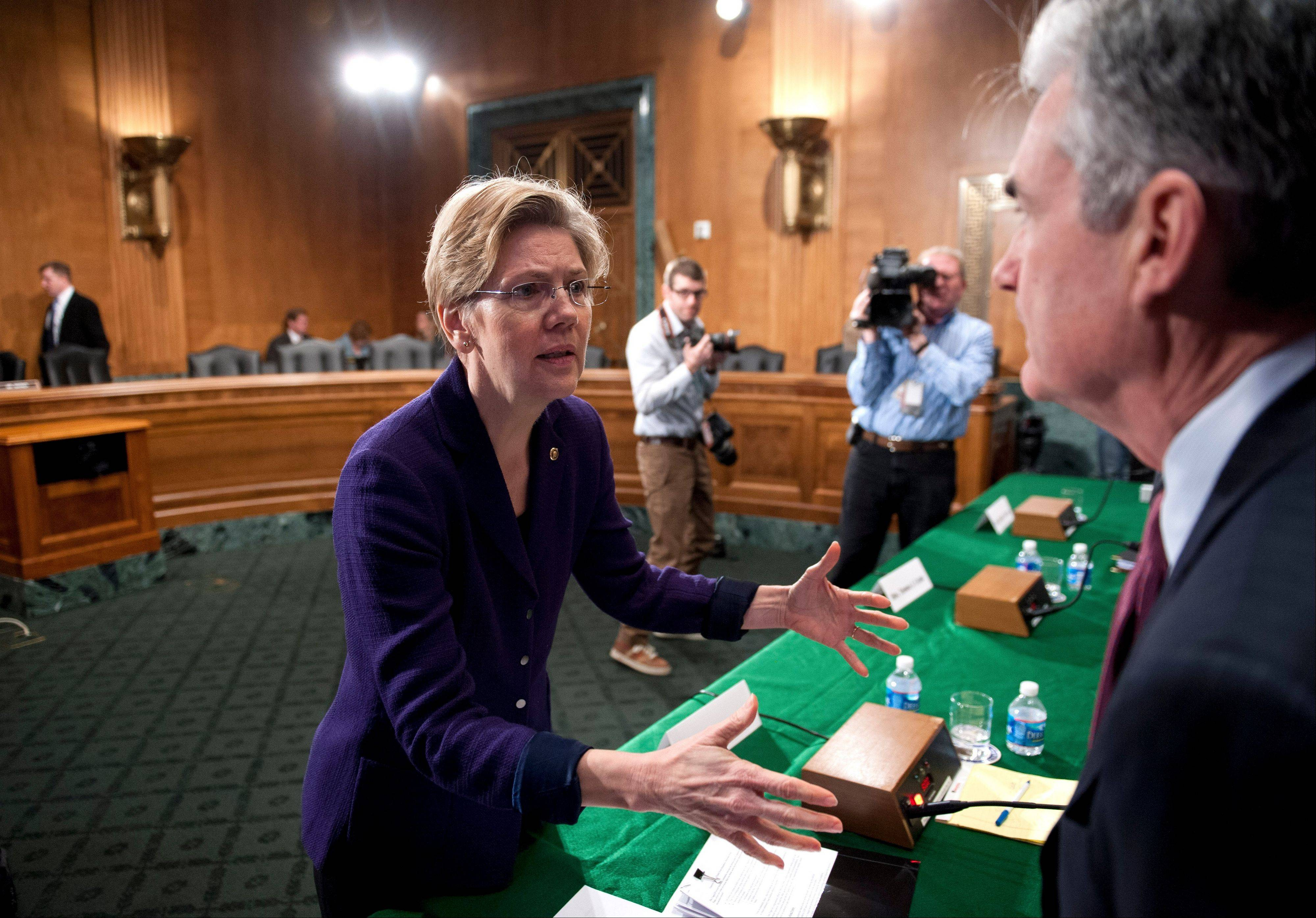 Sen. Elizabeth Warren, a Massachusetts Democrat, questions a witness following a Senate Banking Committee hearing on anti-money laundering on Capitol Hill in Washington .