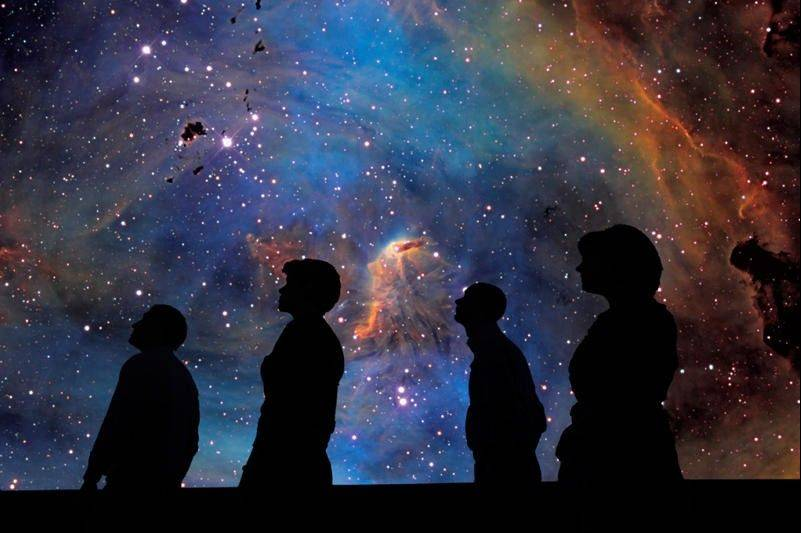 "Take in the exhibit ""Welcome to the Universe"" at the Adler Planetarium."