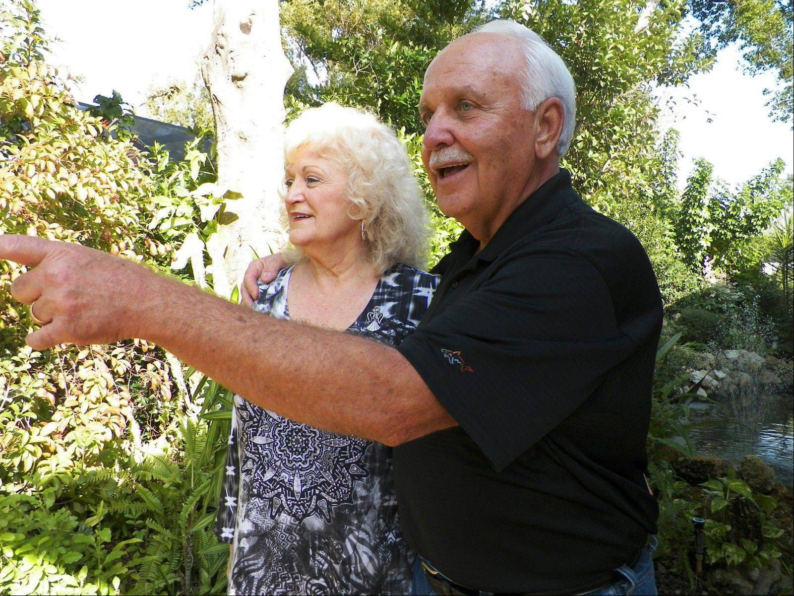 Charlie Majeski points out a favorite garden feature with his wife, Barbara.