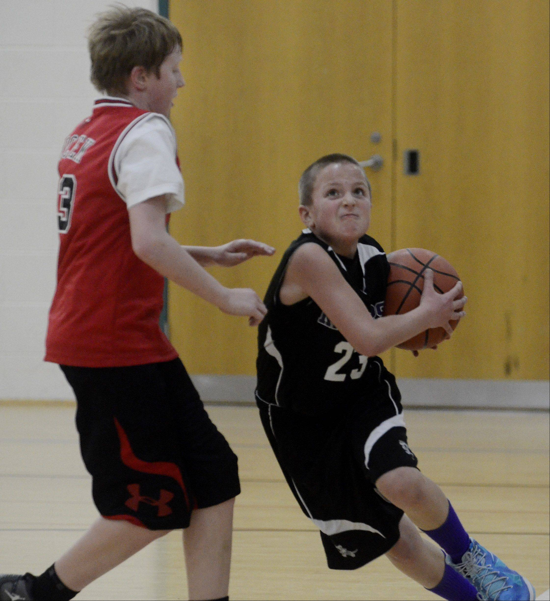 Joey Czaja, right, drives on Robert Nocek during a 10-11-year-olds Youth 3v3 Basketball Tournament game at the Clauss Recreation Center in Roselle.