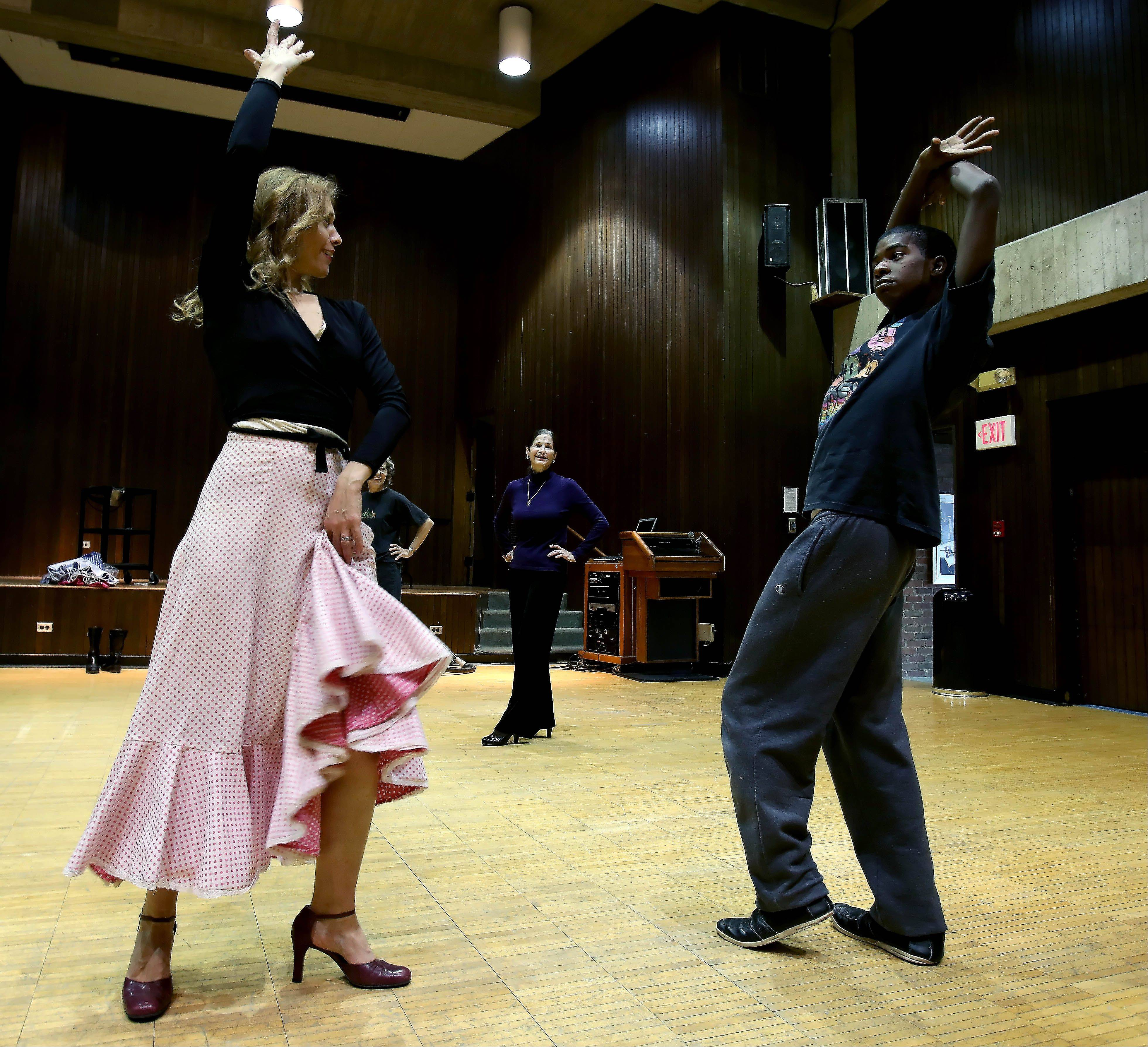 Jelena S�nchez teaches sophmore Aronzo Traylor an ending for a flamenco dance as Rita Dudley of Glendale Heights looks on at North Central College.