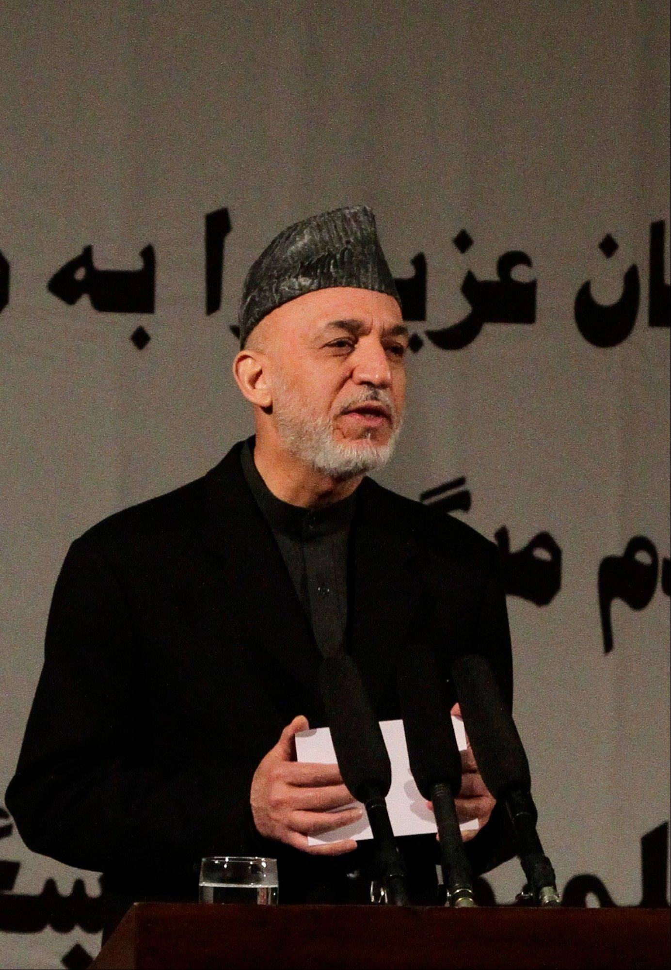 Afghan President Hamid Karzai on Sunday accused the Taliban and the U.S. of working in concert to convince Afghans that violence will worsen if most foreign troops leave as planned by the end of next year.