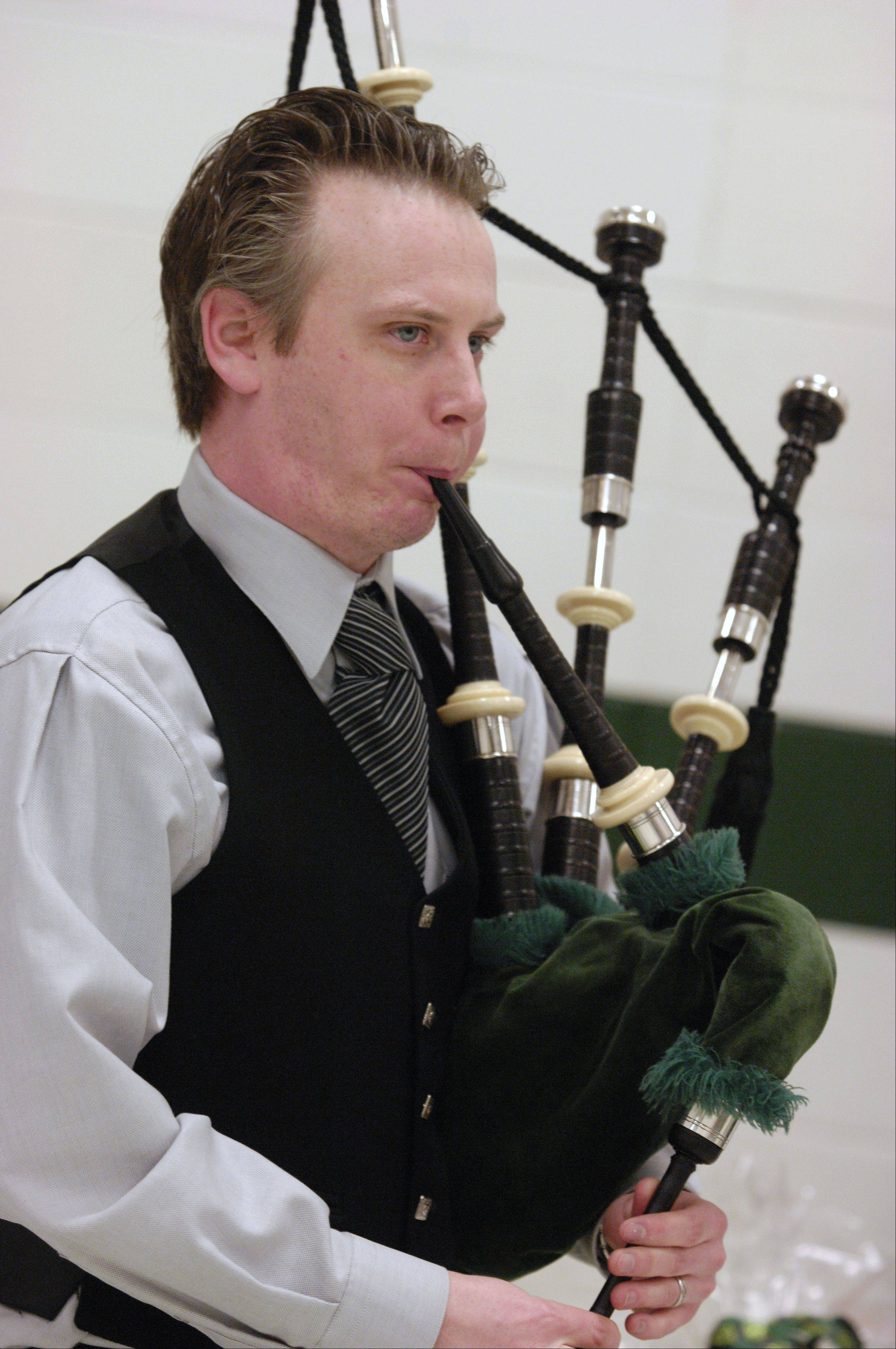 Ian Wallace of St. Charles volunteers to play his bagpipes during the St. Baldrick's Day head shaving event at Evergreen Elementary School in honor of third grader Jack O'Donoghue, who's cancer is now in remission.