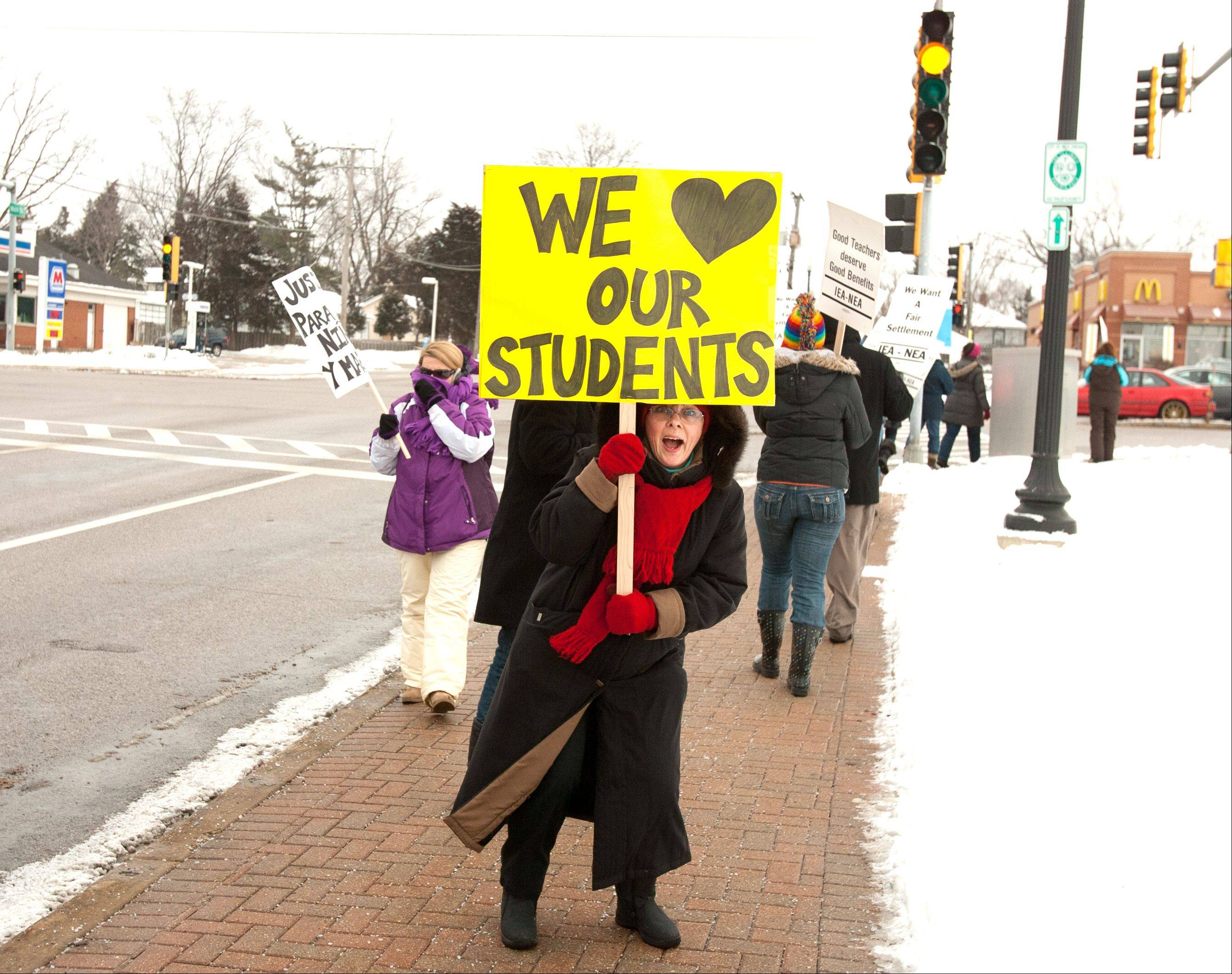 Music teacher Jane Sundberg walks a picket line for West Chicago School District 33 teachers in February.
