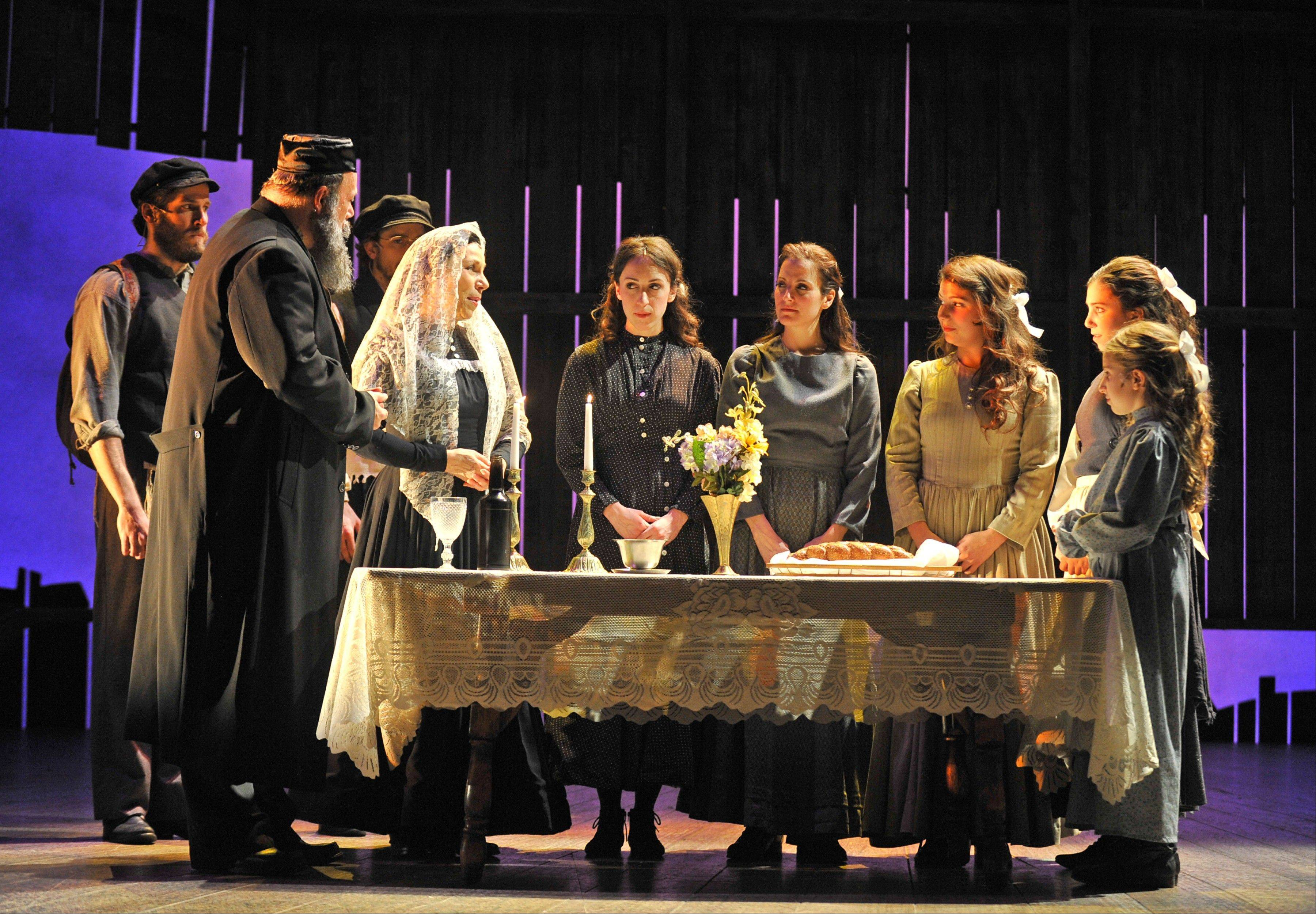 """Sabbath Prayer"" is among the many musical highlights in Paramount Theatre's ""Fiddler on the Roof,"" directed by Jim Corti and starring David Girolmo, second from left, as Tevye, and Iris Lieberman, wearing the white shawl, as his wife, Golde."