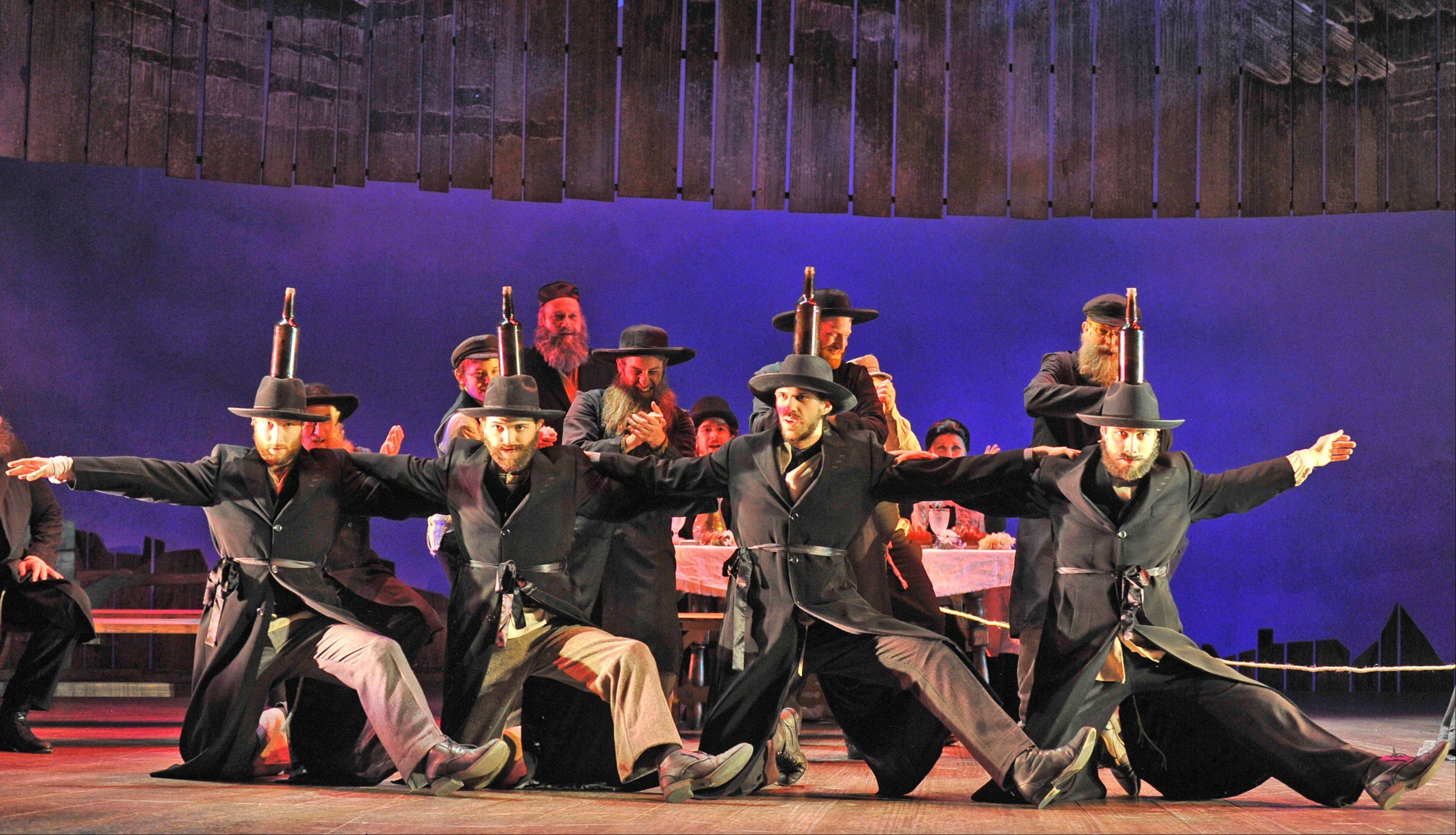 "Tradition dominates the Bottle Dance, an audience favorite, from Paramount Theatre's revival of ""Fiddler on the Roof."""