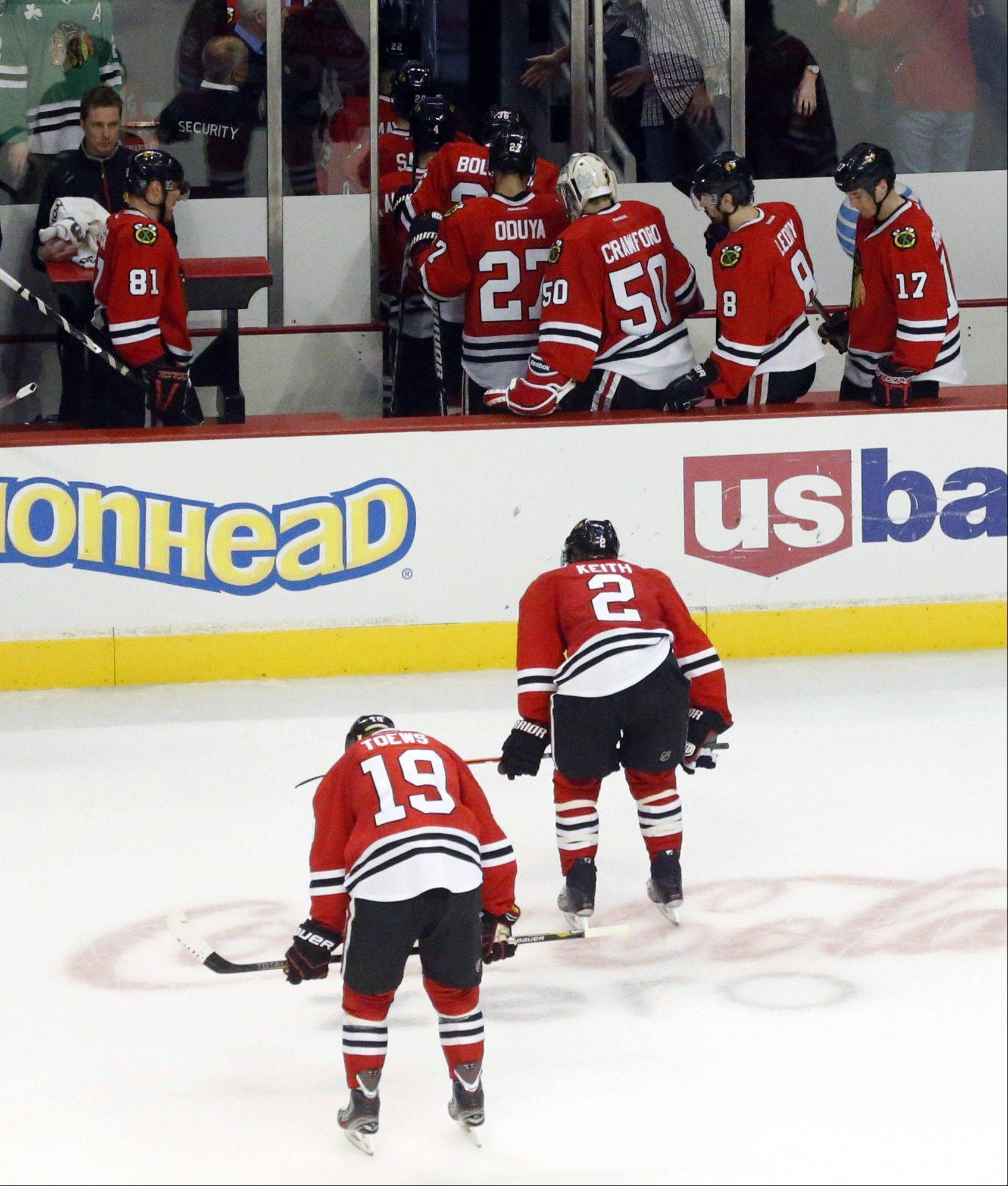 The Blackhawks' Jonathan Toews (19) and Duncan Keith skate to the locker room with teammates after the Blackhawks' 6-5 loss to the Edmonton Oilers on Sunday night at the United Center.