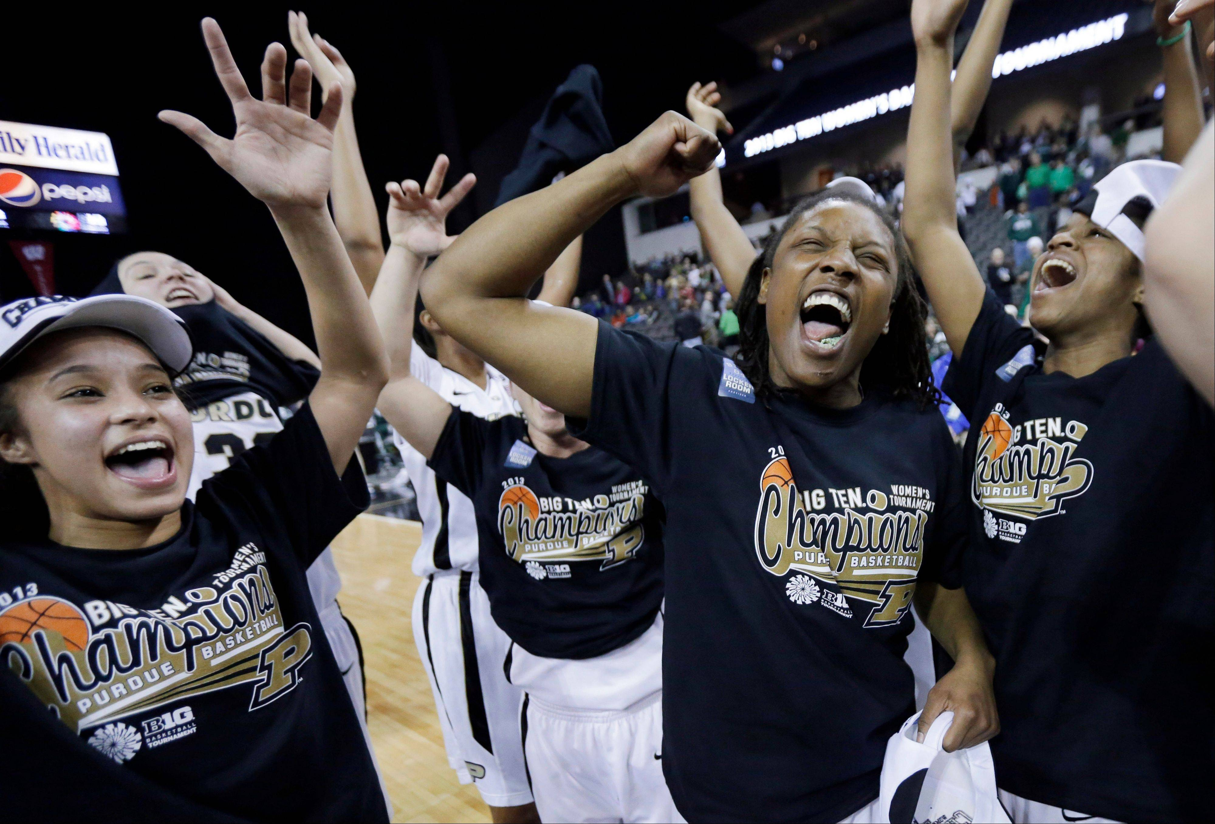 Purdue guard KK Houser, left, guard Chantel Poston, middle, and guard Torrie Thornton celebrate after their 62-47 win over Michigan State in Sunday's Big Ten title game in Hoffman Estates.