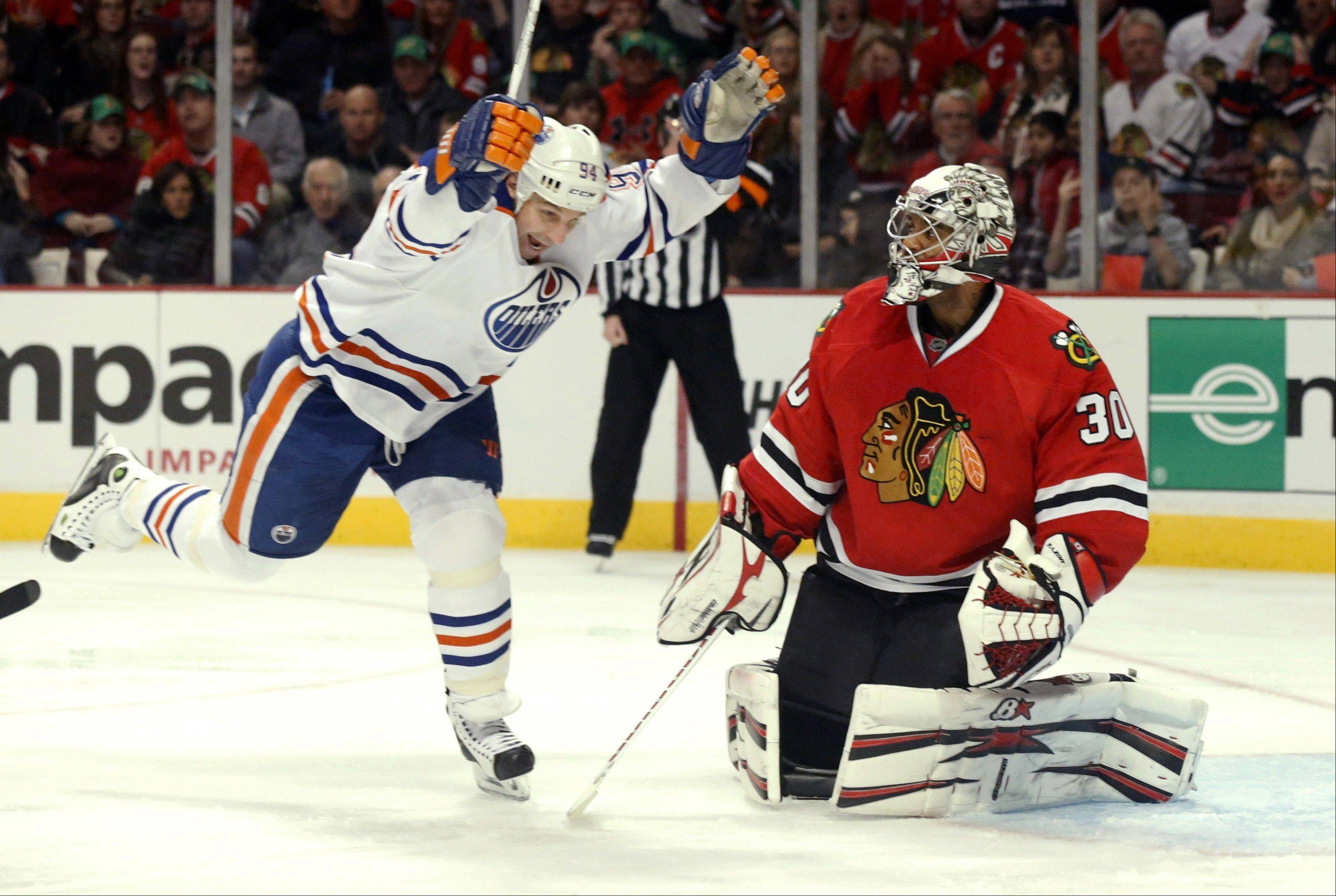 Blackhawks goalie Ray Emery watches as Oilers left wing Ryan Smyth celebrates teammate Mike Brown's goal Sunday night during the first period, when Edmonton took a 4-0 lead.