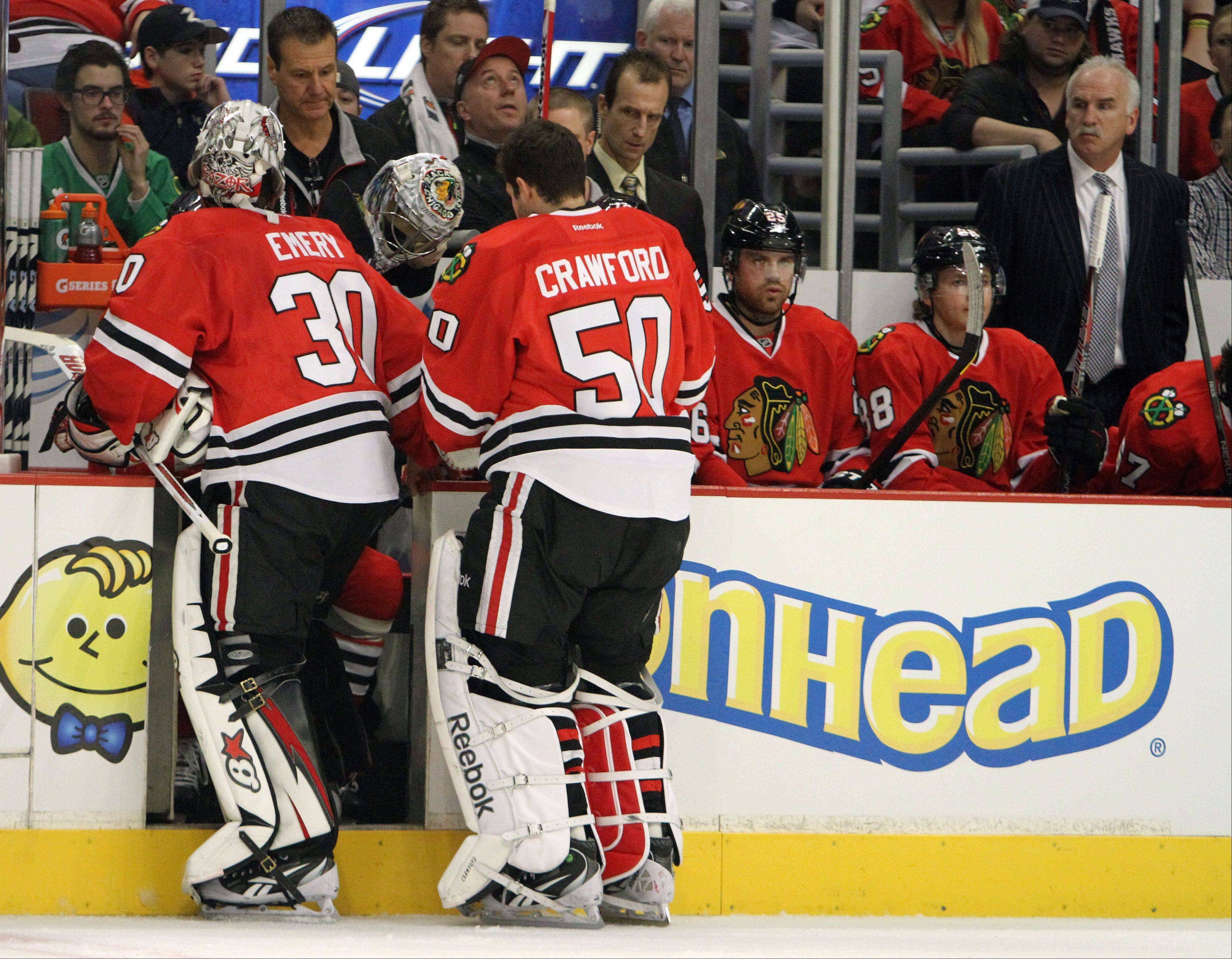 Chicago Blackhawks goalie Ray Emery is replaced by Corey Crawford in the first period during their game Sunday night at the United Center in Chicago.
