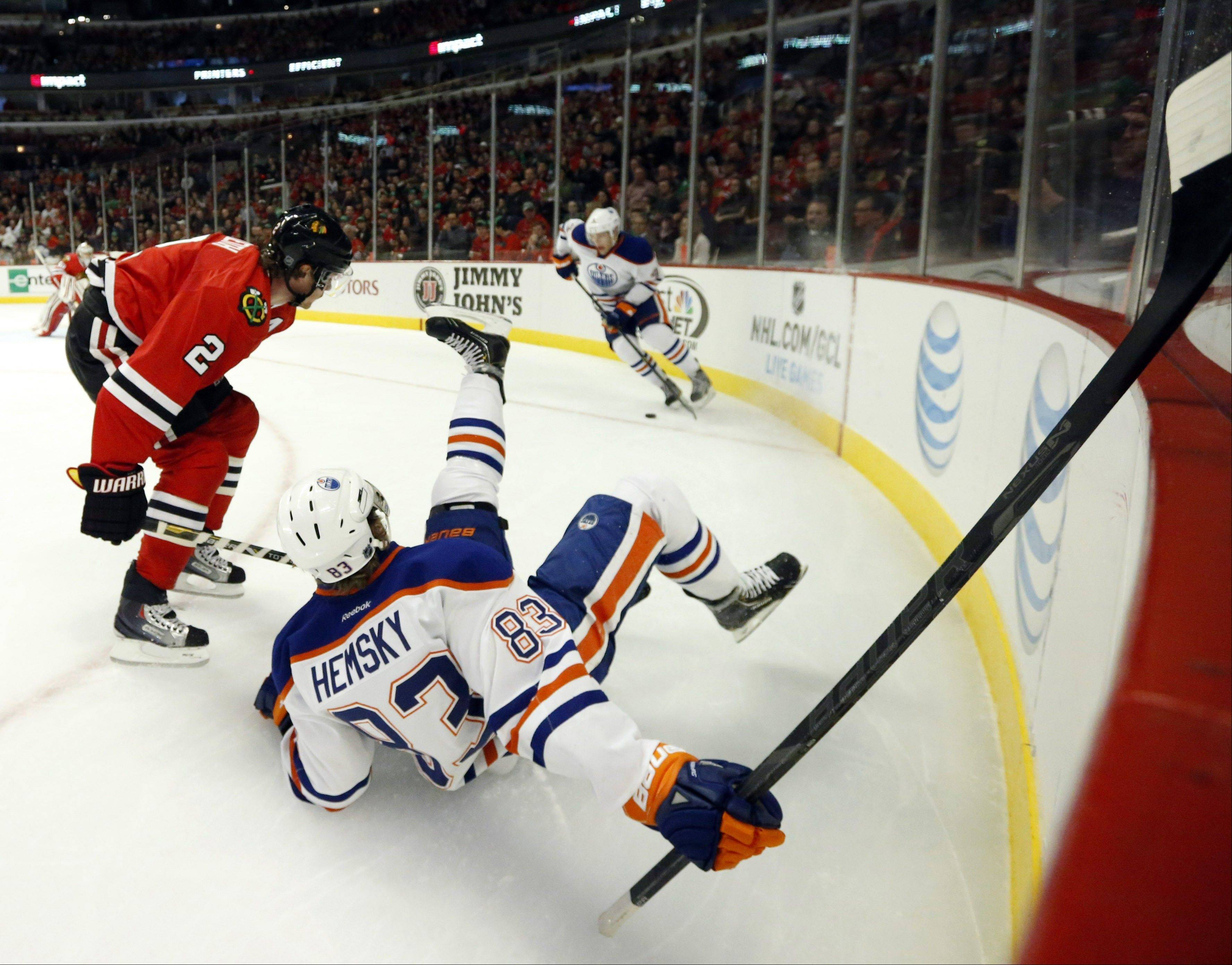 ASSOCIATED PRESS Chicago Blackhawks defenseman Duncan Keith (2) checks Edmonton Oilers right wing Ales Hemsky, from the Czech Republic, to the ice during the first period.