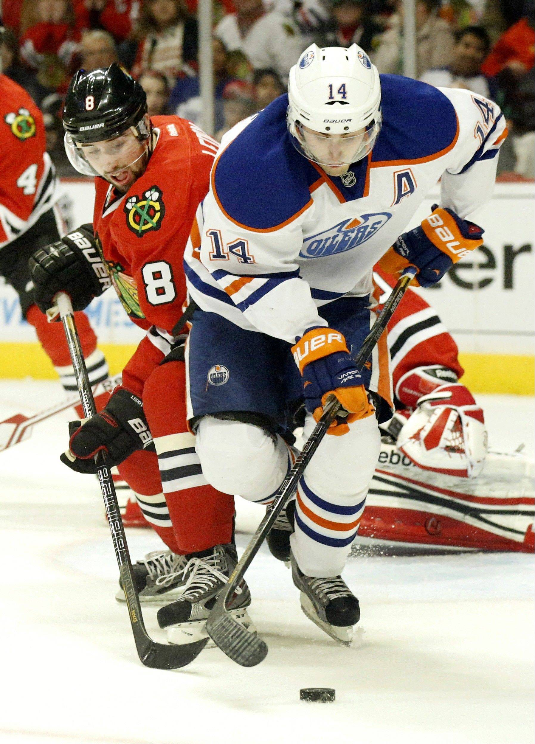 ASSOCIATED PRESS Chicago Blackhawks defenseman Nick Leddy (8) battles Edmonton Oilers center Jordan Eberle (14) for the puck during the first period.