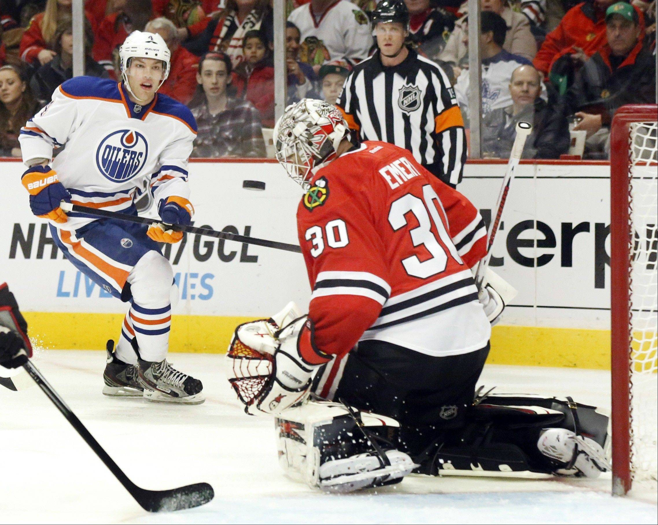 ASSOCIATED PRESS Chicago Blackhawks goalie Ray Emery makes a chest save on a shot by Edmonton Oilers left wing Taylor Hall, background, during the first period.
