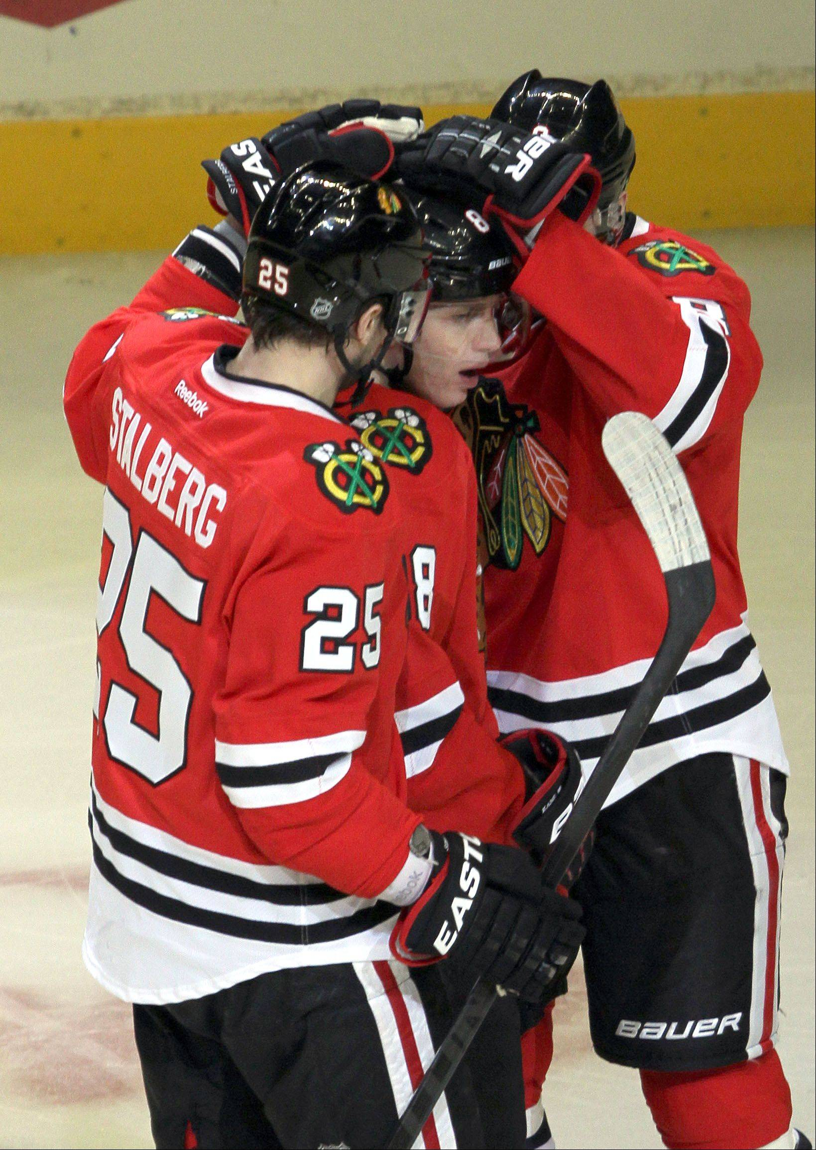 Chicago Blackhawks Viktor Stalberg and Nick Leddy celebrate with Patrick Kane after his 2nd period goal during their game Sunday night at the United Center in Chicago.