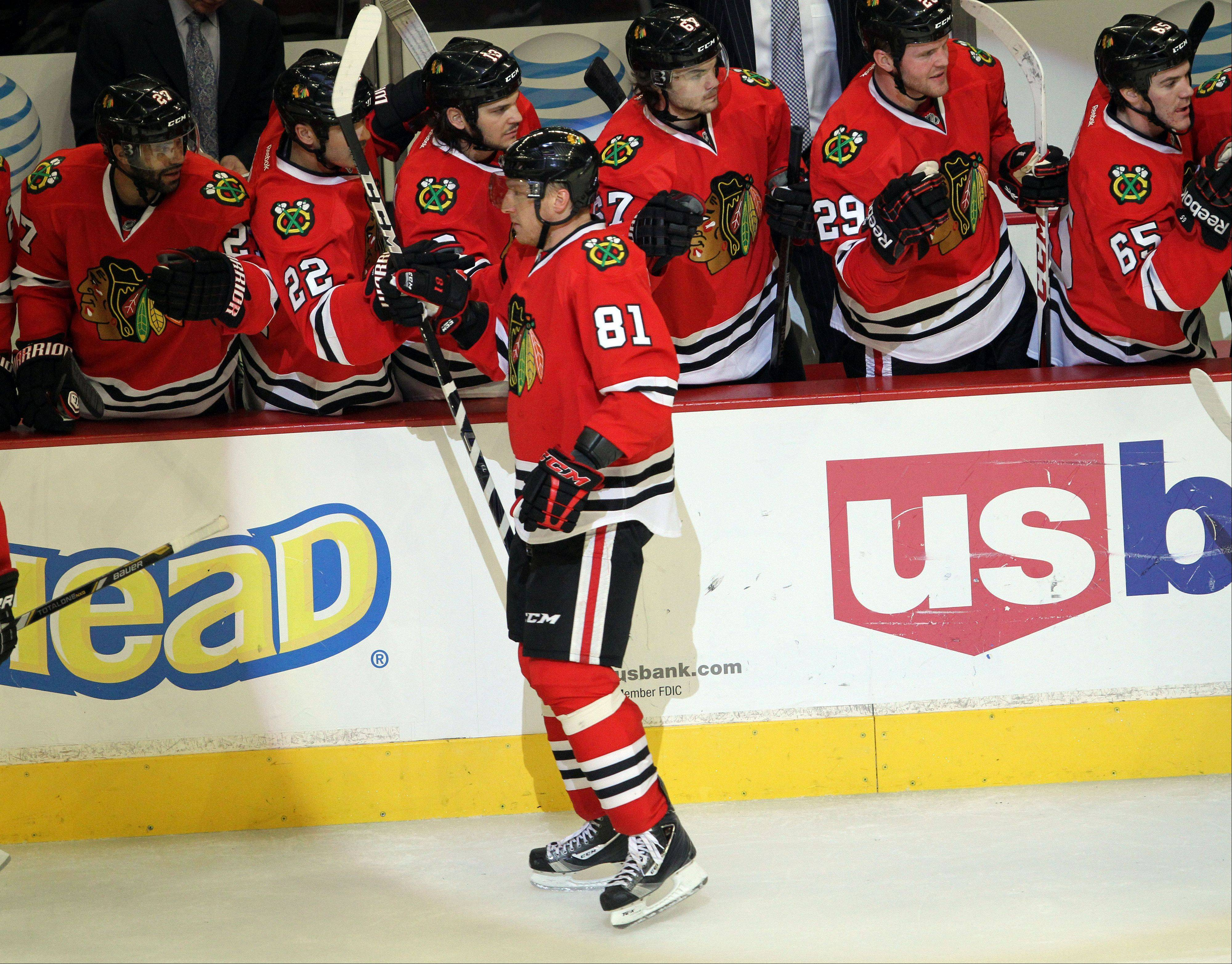 Chicago Blackhawks right wing Marian Hossa celebrates with the bench after a 2nd period goal during their game Sunday night at the United Center in Chicago.
