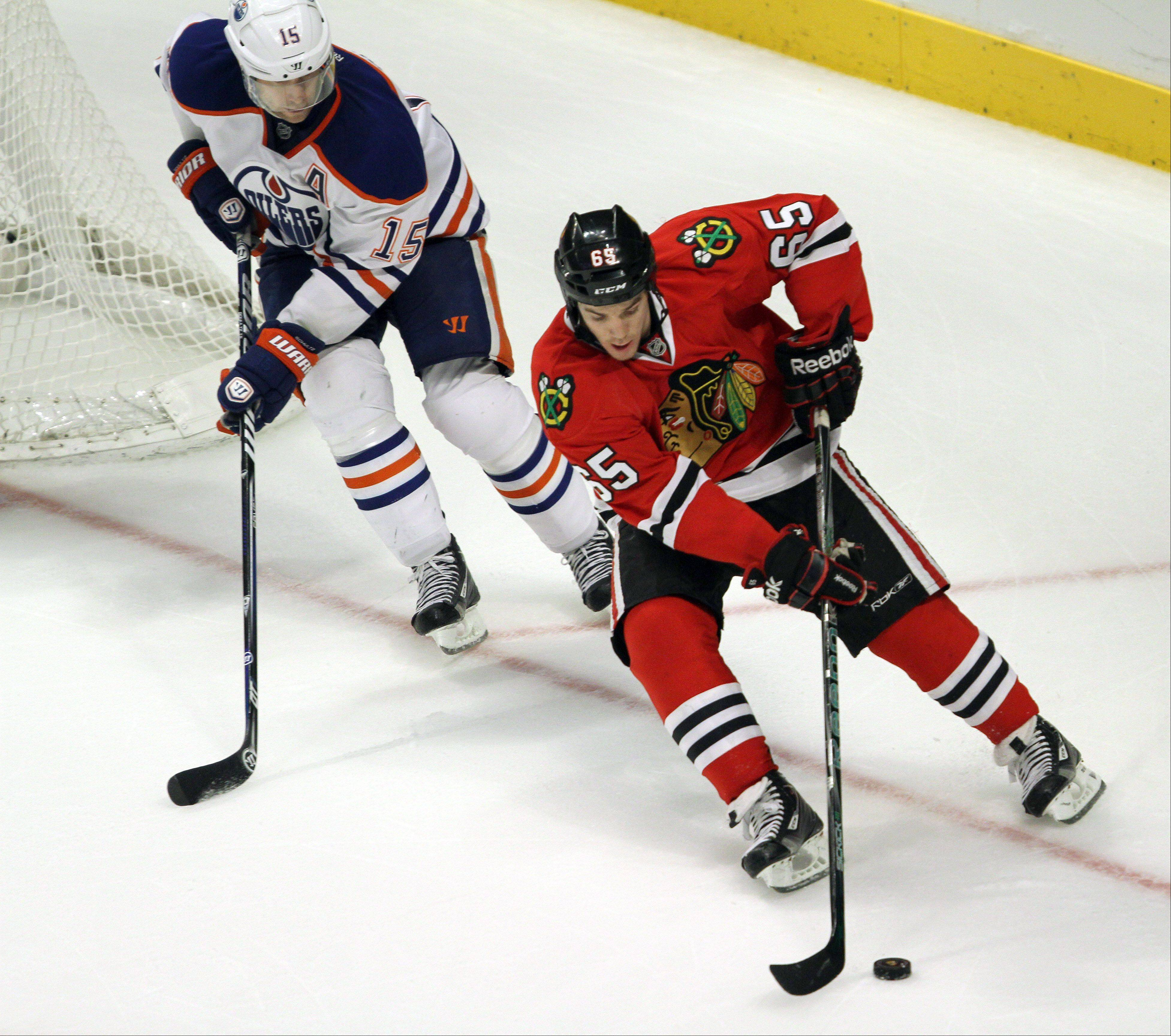 Chicago Blackhawks left wing Viktor Stalberg maneuvers around Edmonton Oilers defenseman Nick Schultz during their game Sunday night at the United Center in Chicago.