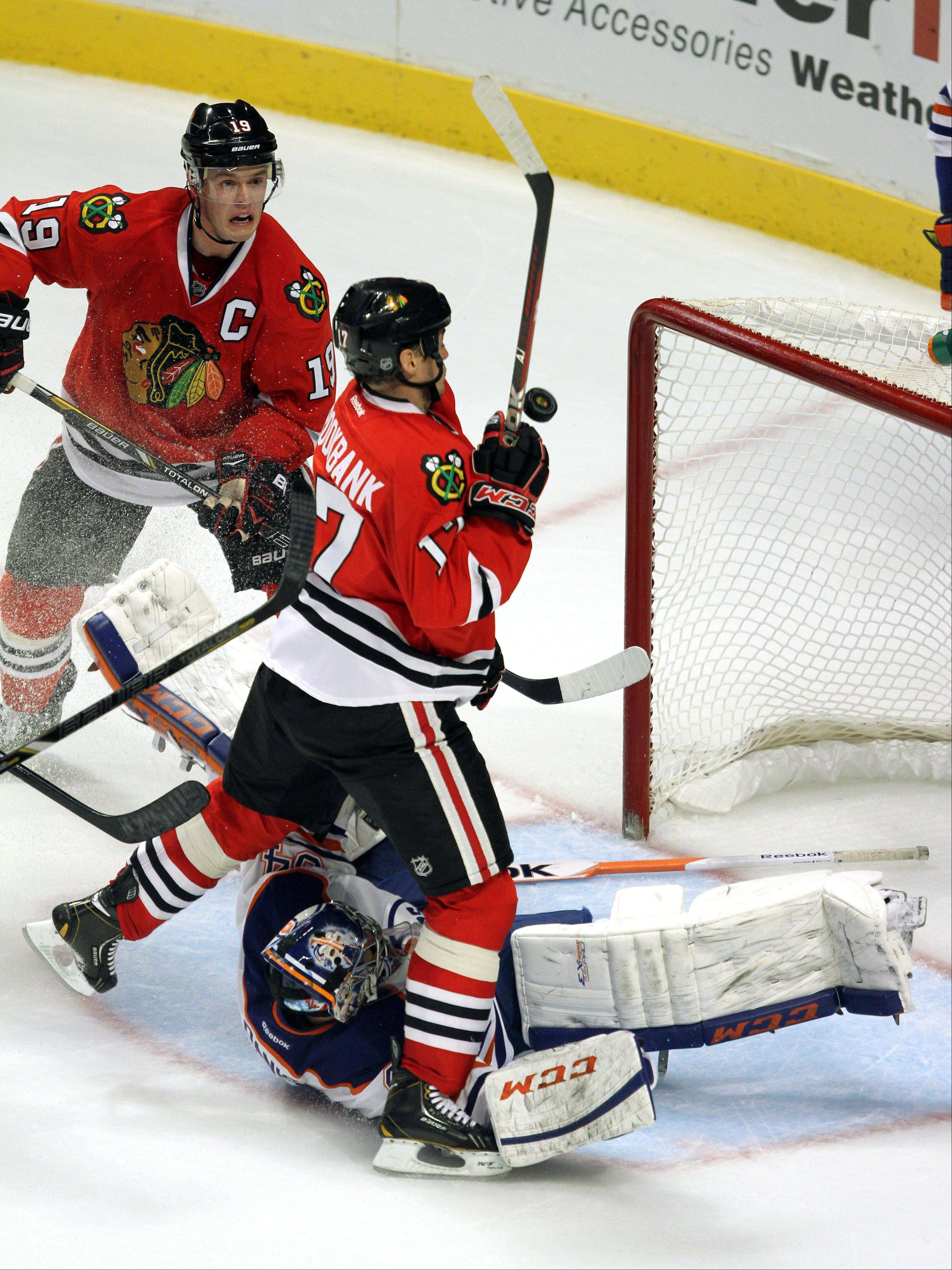 the puck bounces off Chicago Blackhawks defenseman Sheldon Brookbank's chest and into the net in the 2nd period during their game Sunday night at the United Center in Chicago.