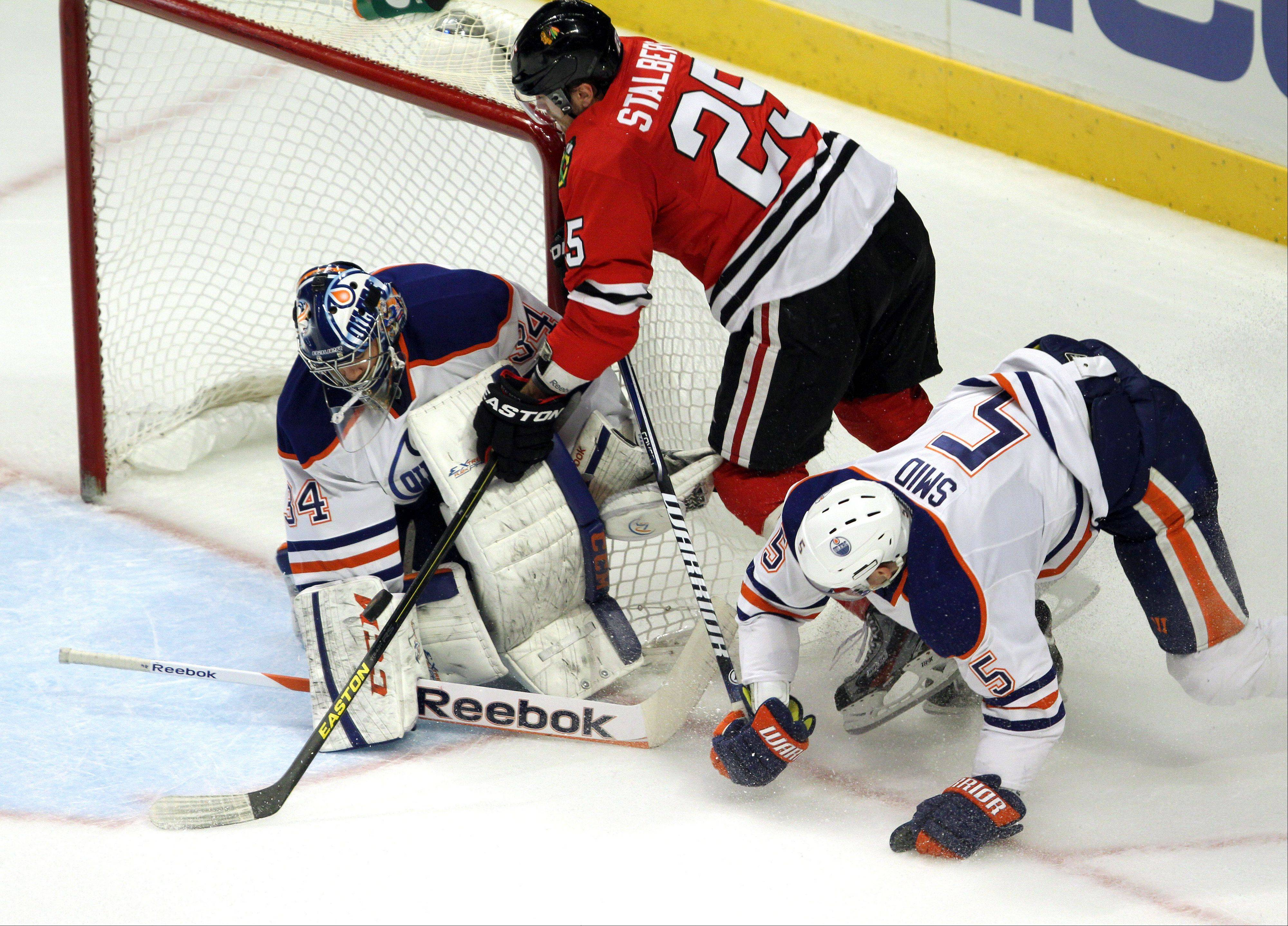 Chicago Blackhawks left wing Viktor Stalberg shoots on Edmonton Oilers goalie Yann Danis during their game Sunday night at the United Center in Chicago.