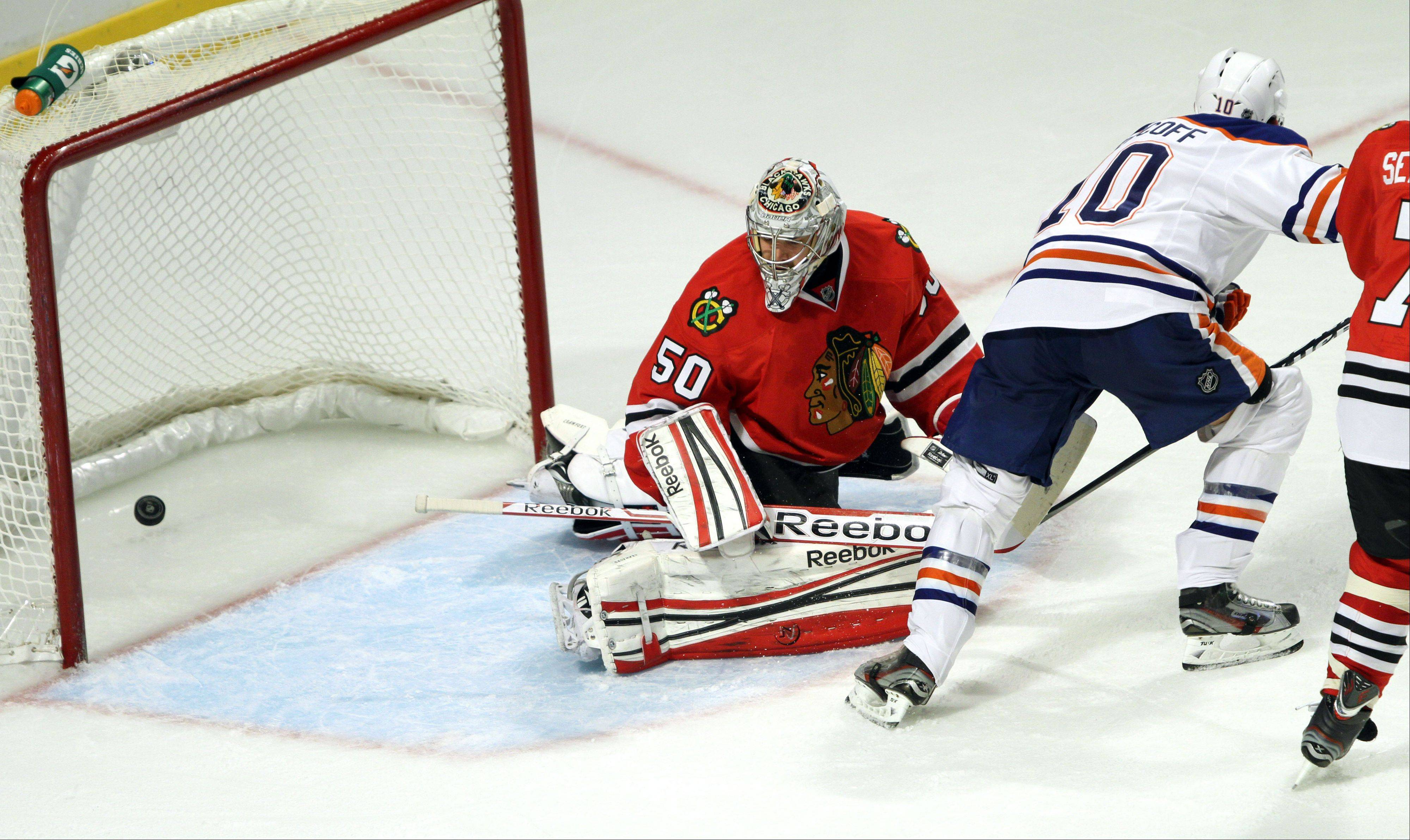 Edmonton Oilers center Shawn Horcoff scores on Chicago Blackhawks goalie Corey Crawford in the second period during their game Sunday night at the United Center in Chicago.