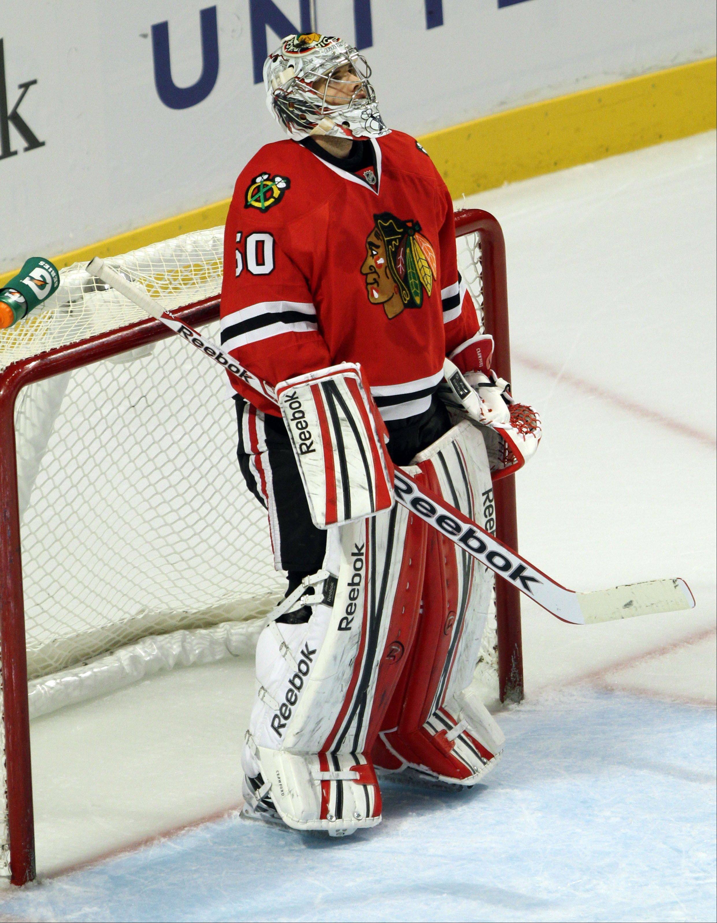 Chicago Blackhawks goalie Corey Crawford looks to the scoreboard after letting in a goal in the 2nd period during their 6-5 loss to the Edmonton Oilers Sunday night at the United Center in Chicago.