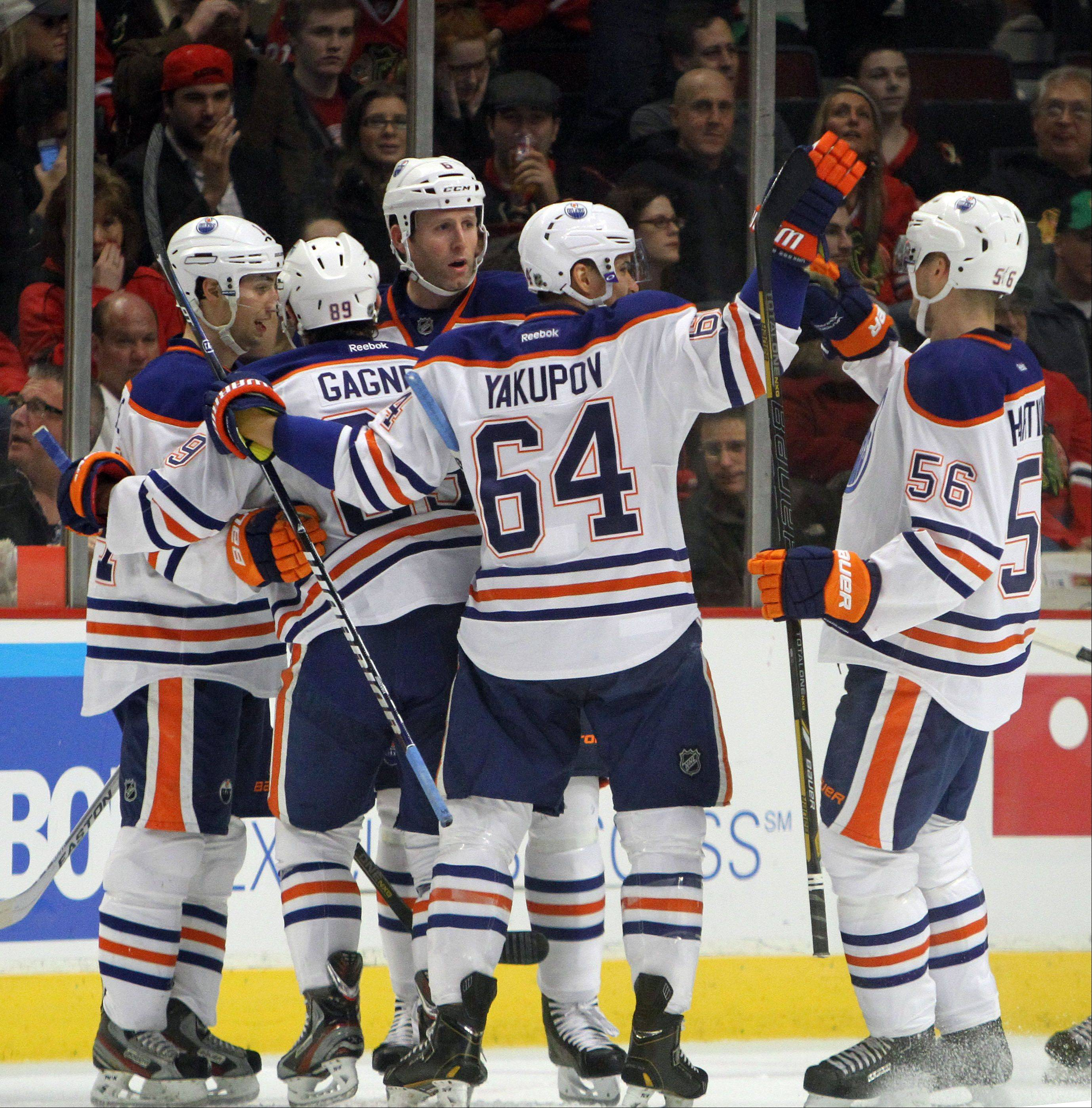 Edmonton Oilers players celebrate after a first-period goal during their game Sunday night at the United Center in Chicago.