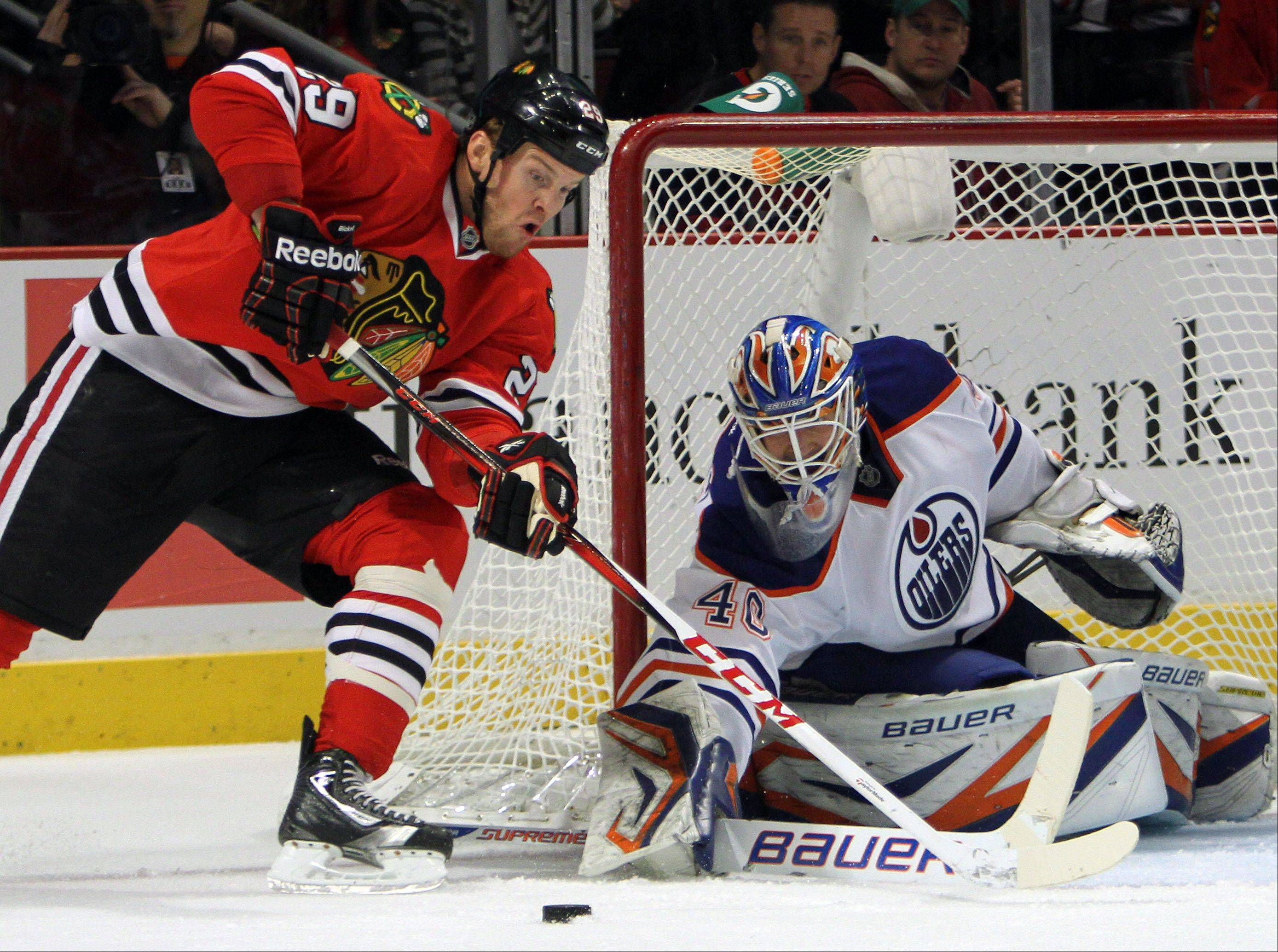 Chicago Blackhawks left wing Bryan Bickell gets a scoring opportunity against Edmonton Oilers goalie Devan Dubnyk during their game Sunday night at the United Center in Chicago.