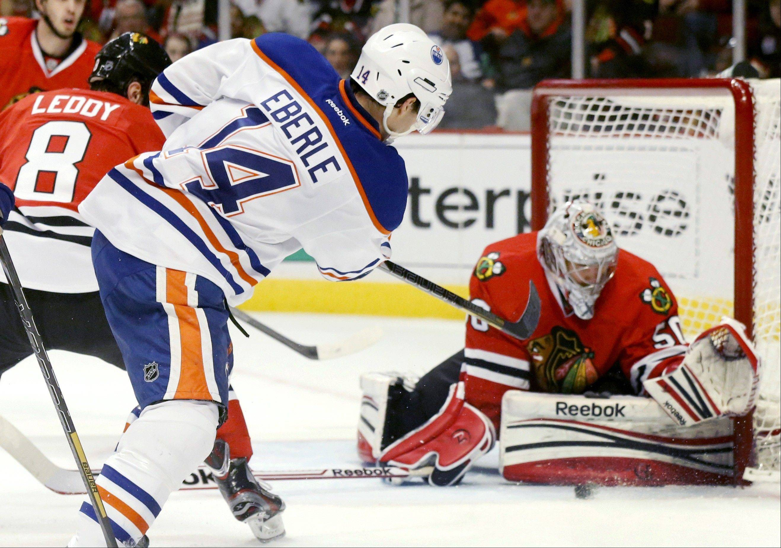 ASSOCIATED PRESSChicago Blackhawks goalie Corey Crawford makes a save on a shot by Edmonton Oilers center Jordan Eberle (14) during the first period. Crawford replaced Emery after Emery gave up three goals in the first.