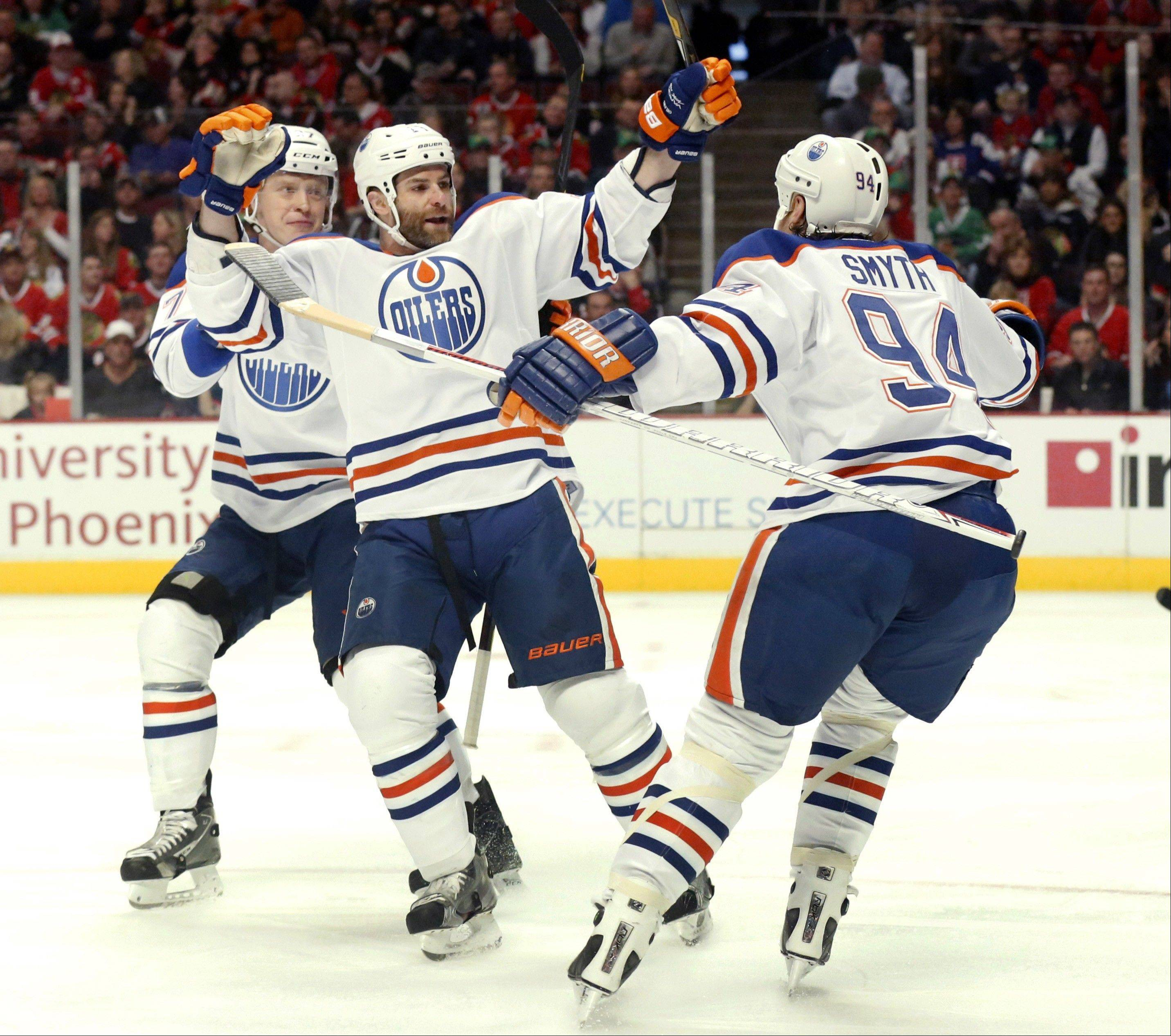 ASSOCIATED PRESS Edmonton Oilers' Mike Brown, center, celebrates his goal with teammate Lennart Petrell (37), from Finland, and Ryan Smyth (94) during the first period.