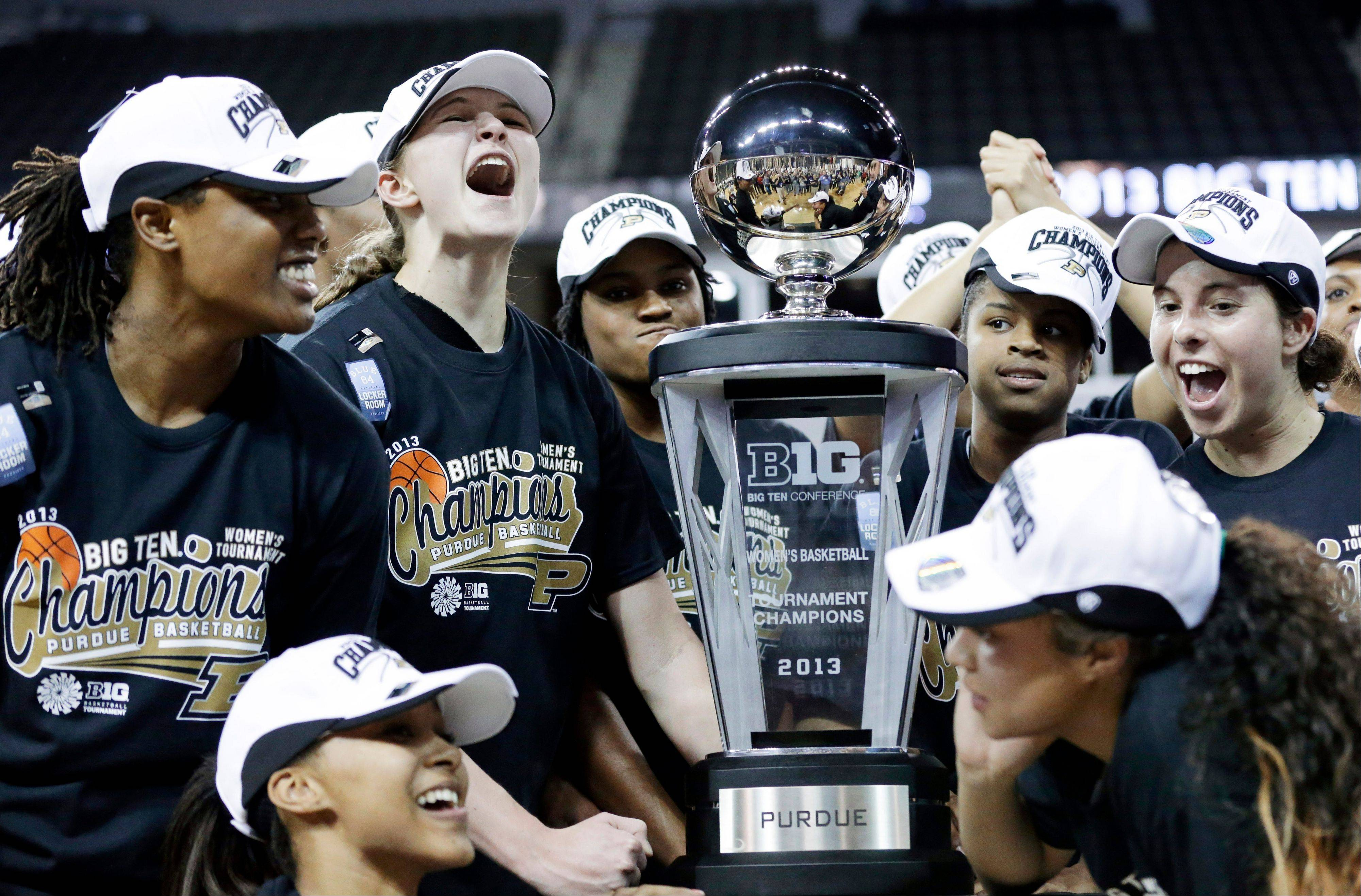 Purdue players celebrate with the trophy after their 62-47 win over Michigan State in the Big Ten women's basketball title game at Sears Centre in Hoffman Estates.