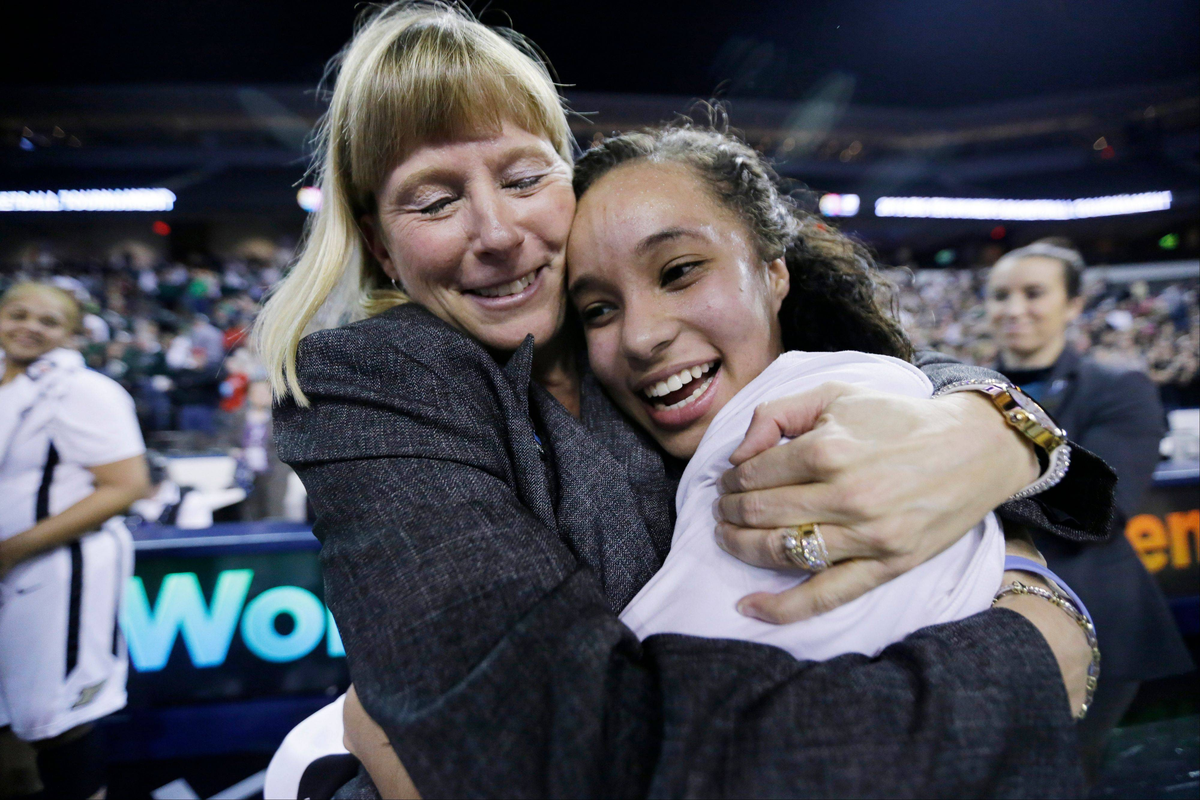Purdue head coach Sharon Versyp, left, celebrates with guard KK Houser after Purdue defeated Michigan State 62-47 in the Big Ten women's basketball title game at Sears Centre in Hoffman Estates.